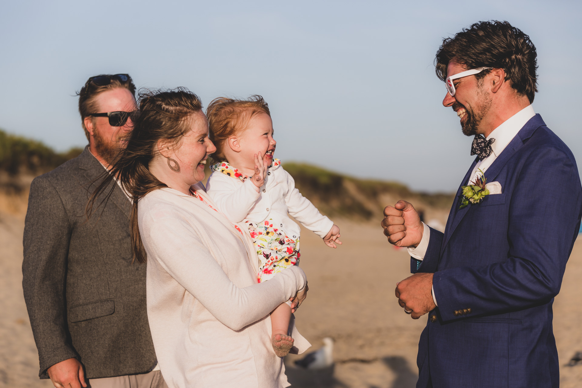 New England Beach Elopement and Elopement Photography | The groom and a few of the guests
