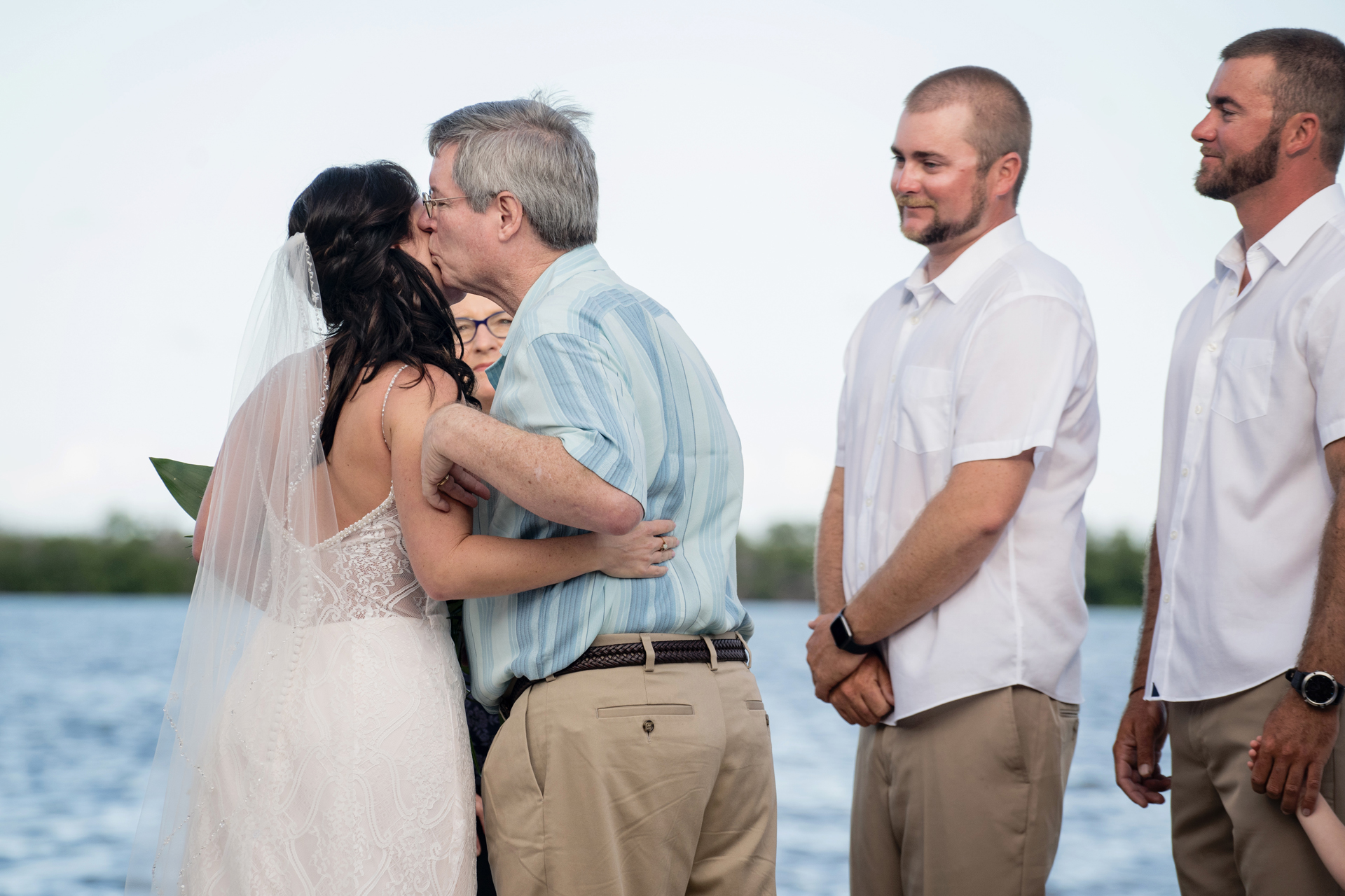 Florida Keys Beach Wedding Ceremony Picture - Bride Getting Dad Kiss | The bride's father kisses his daughter's cheek after escorting her down the aisle