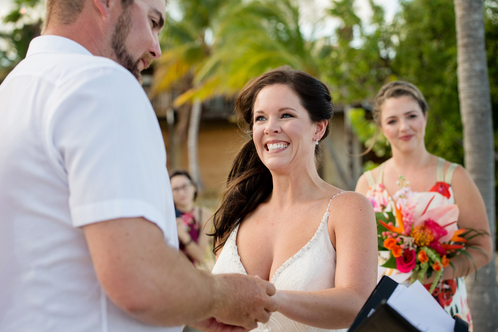 Beach Wedding Elopement Ceremony Photographer - Bride and Groom in Florida Keys  | The bride's eyes sparkle as she beams up at her new husband