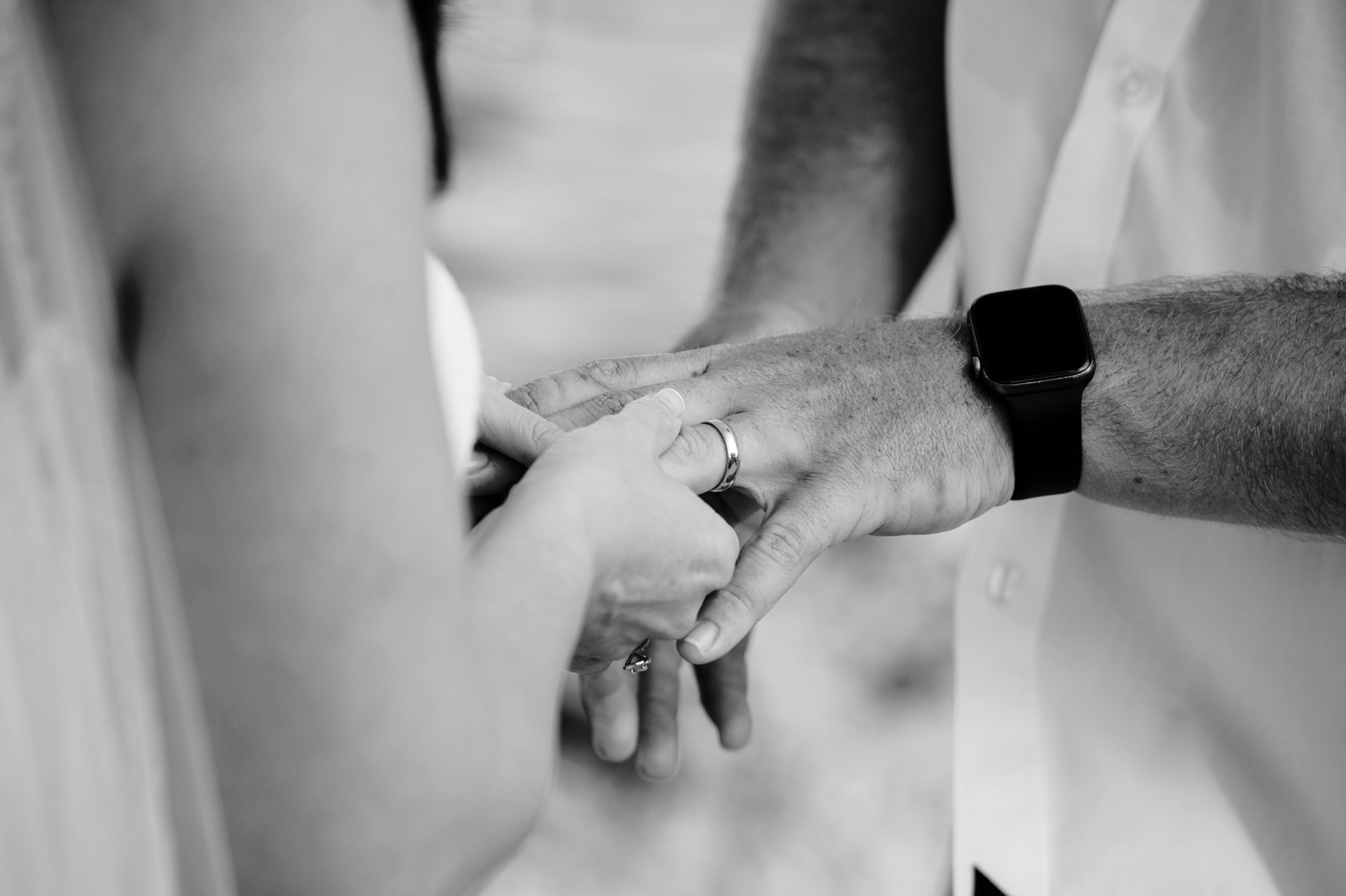 Beach Elopement Detail Image - Ring Ceremony in Florida Keys | The bride slips her husband's wedding band onto his ring finger