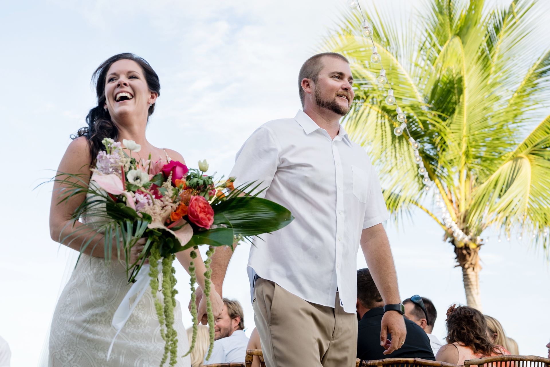 Outdoor FL Beach Wedding Ceremony Photography | Hand in hand, the newlyweds walk down the aisle