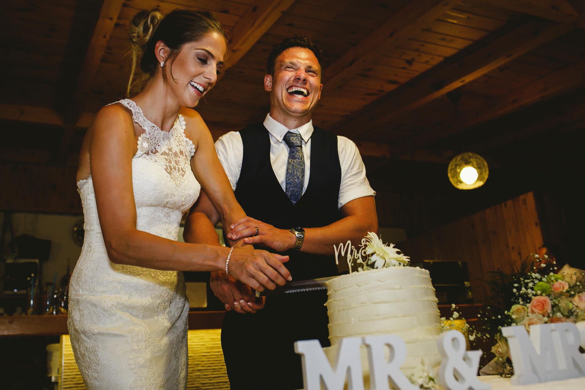 Fethiye, Turkey Wedding Cake Cutting Image | The wedding cake cutting ceremony was such a playful moment