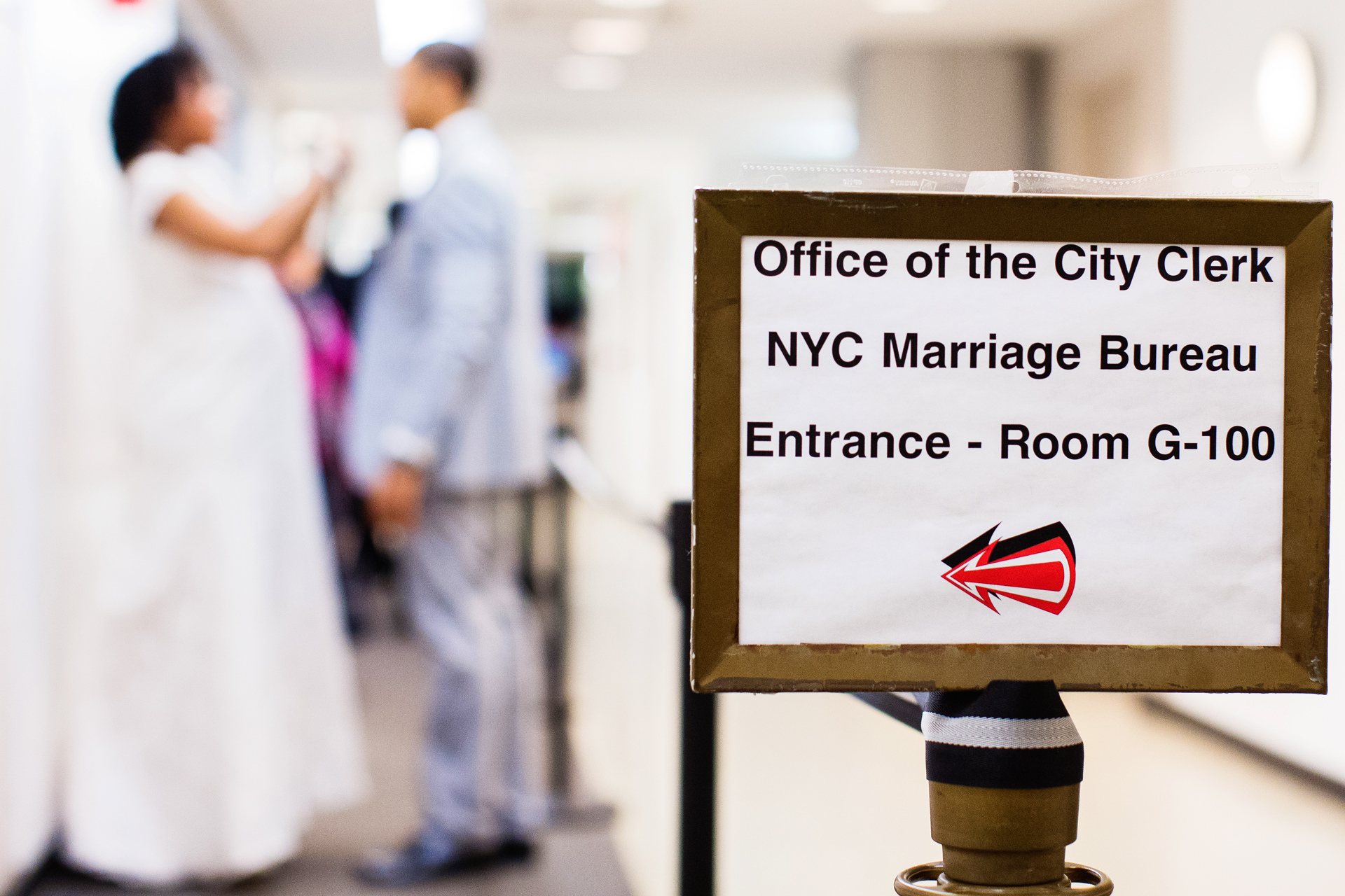 NYC - Queens Elopement Photography | they await their turn in line at the New York City Marriage Bureau