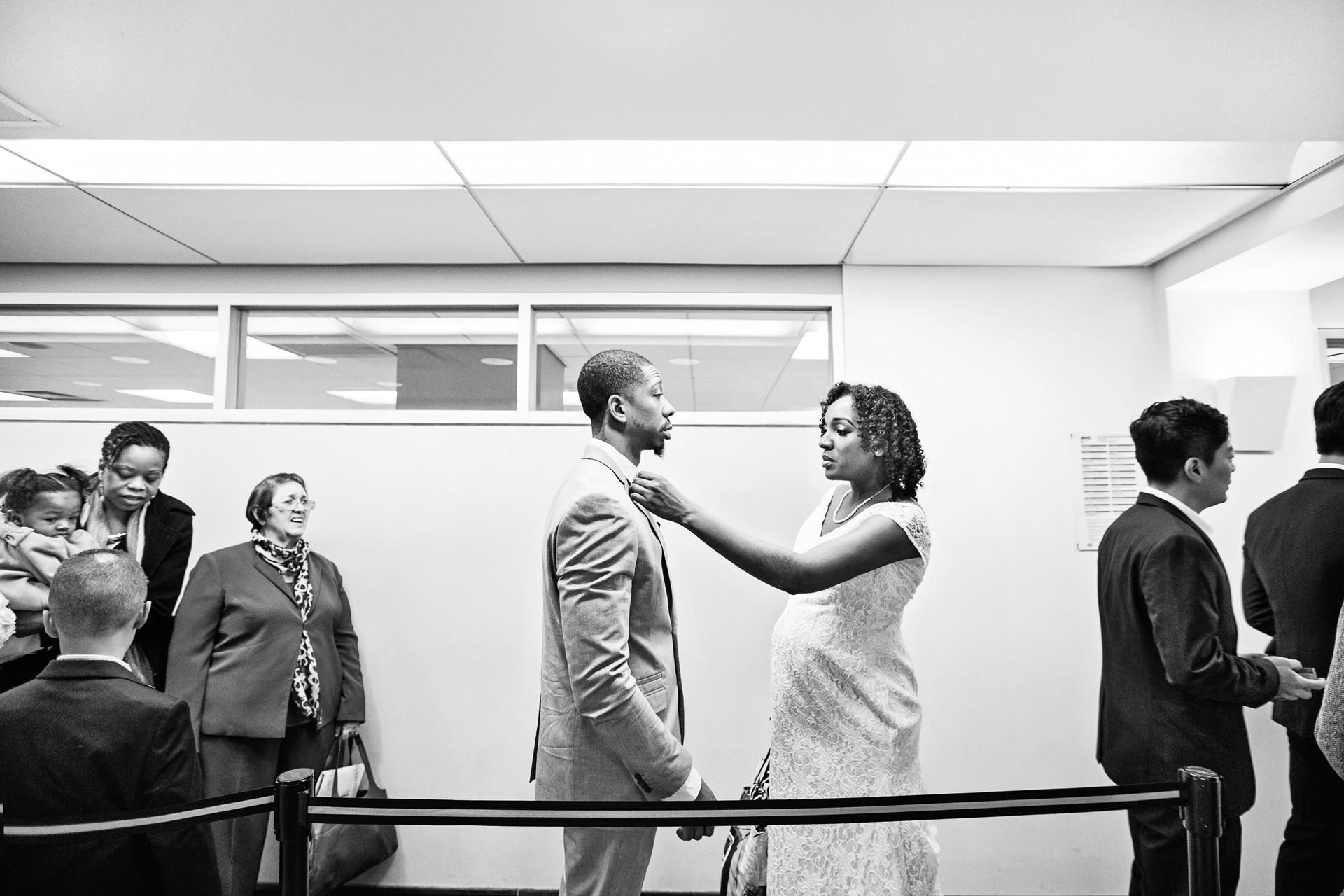 Queens, NYC - Elopement Wedding Picture | The bride straightens Junior's collar