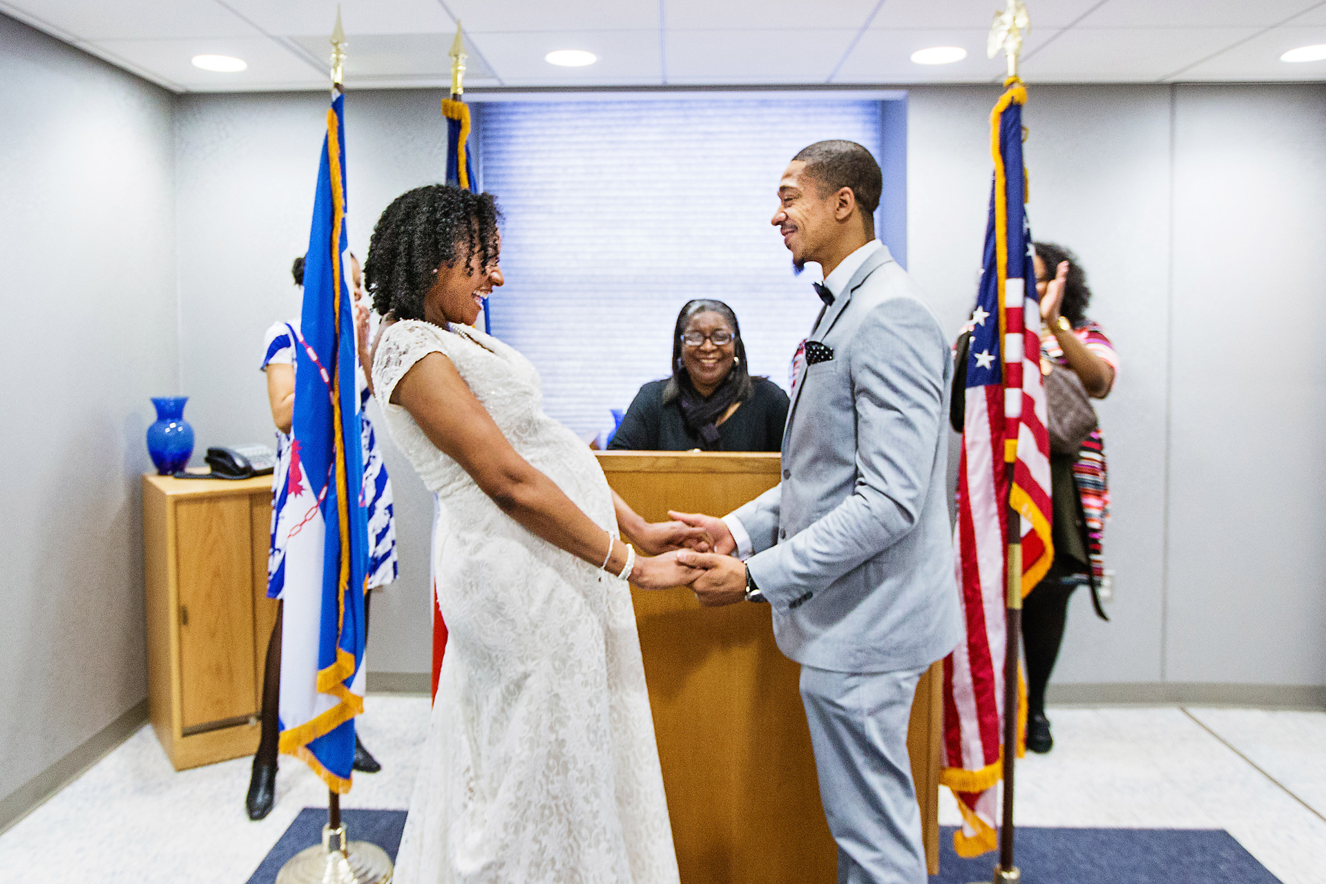 NYC Marriage Bureau Elopement Ceremony Image | The bride and groom beam and giggle at each other