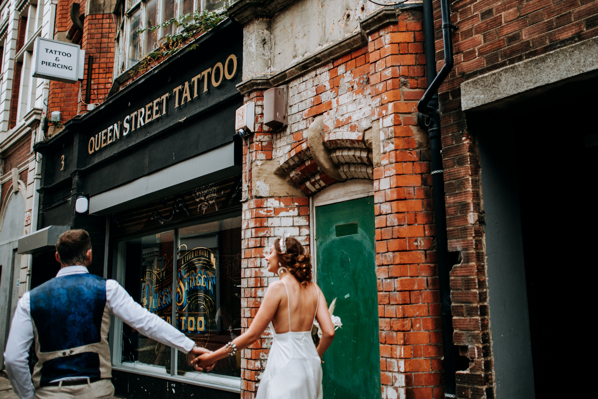 United Kingdom Wedding Reportage Photography | the couple arriving at the Queen Street Tattoo Parlour in Hull