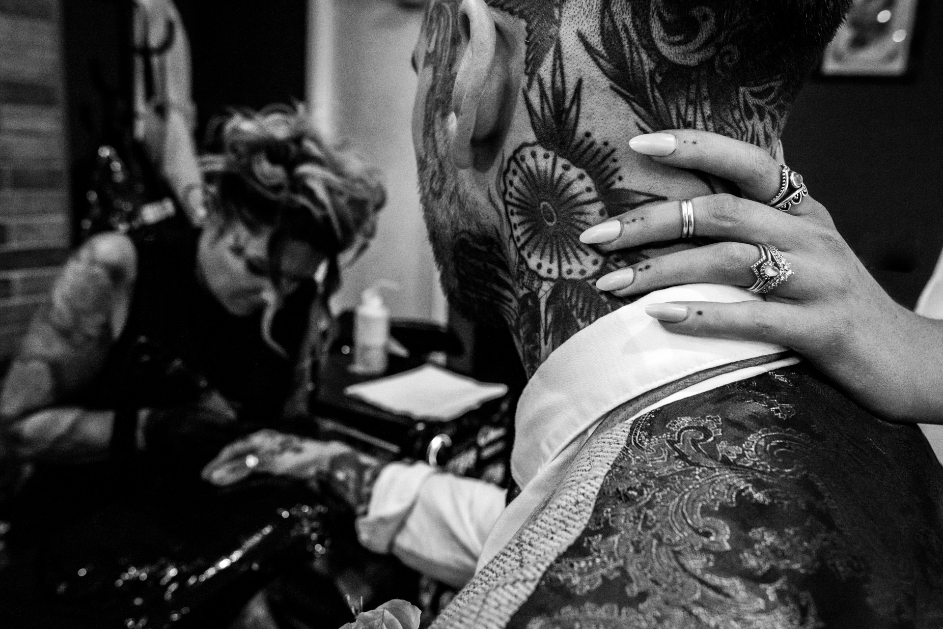 UK Wedding Reportage Detail Image | the bride tenderly places her hand on the back the grooms neck