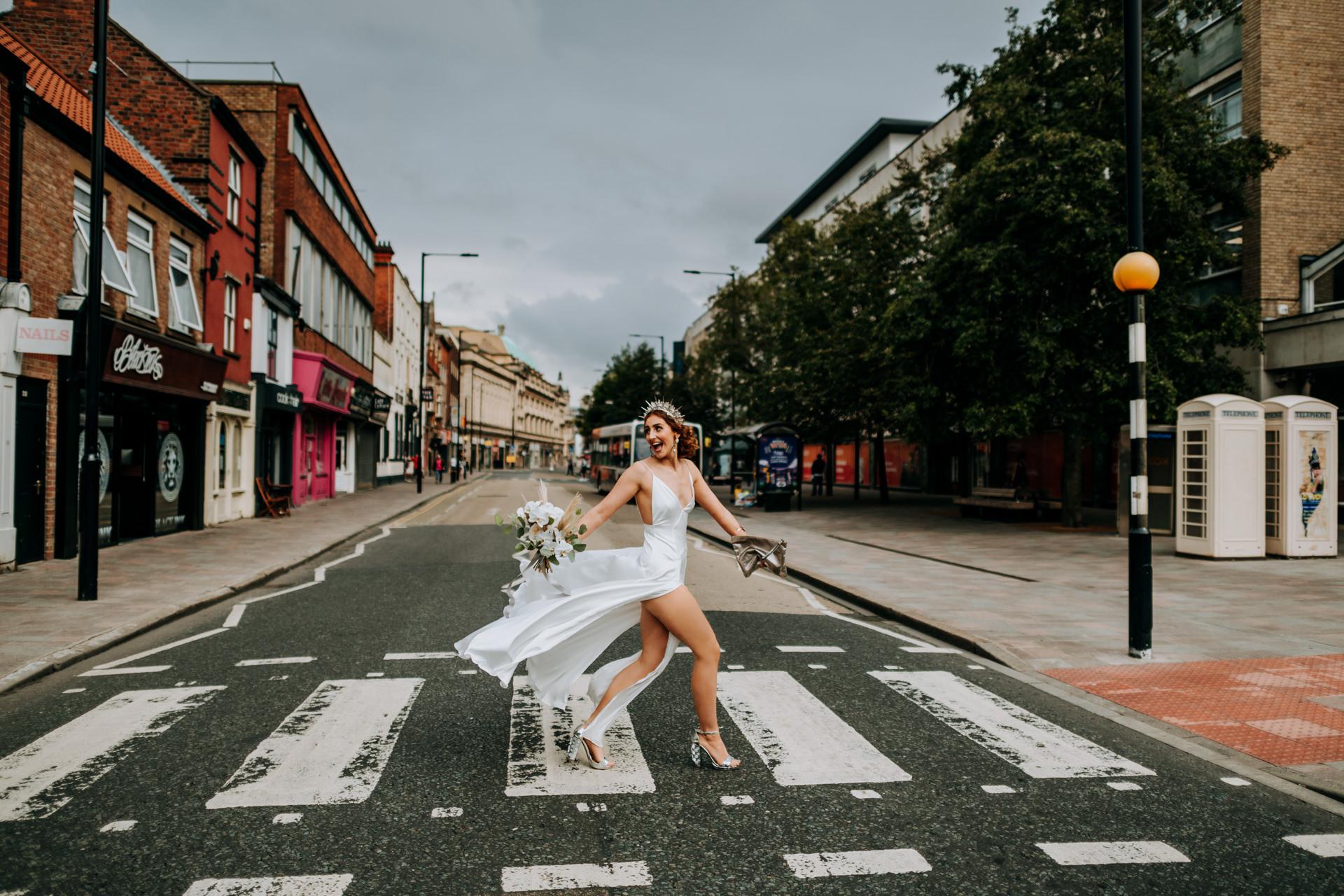 UK Wedding Bride Image | the bride crosses an eerily empty road