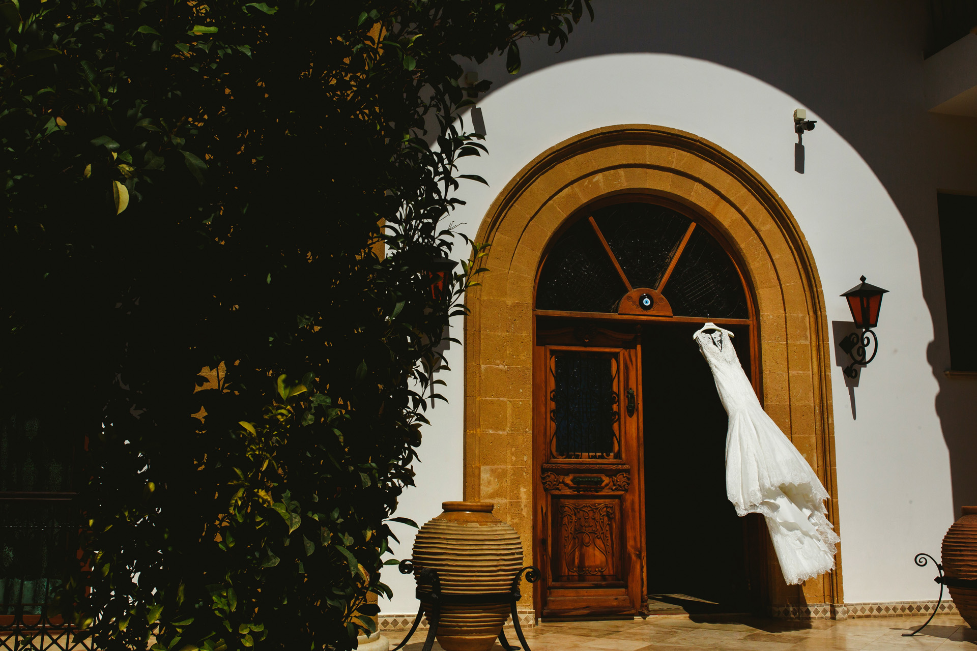 Cyprus Wedding Elopement Bridal Dress Detail Picture | bride's gown hanging At the gate of the venue, Di Figaro