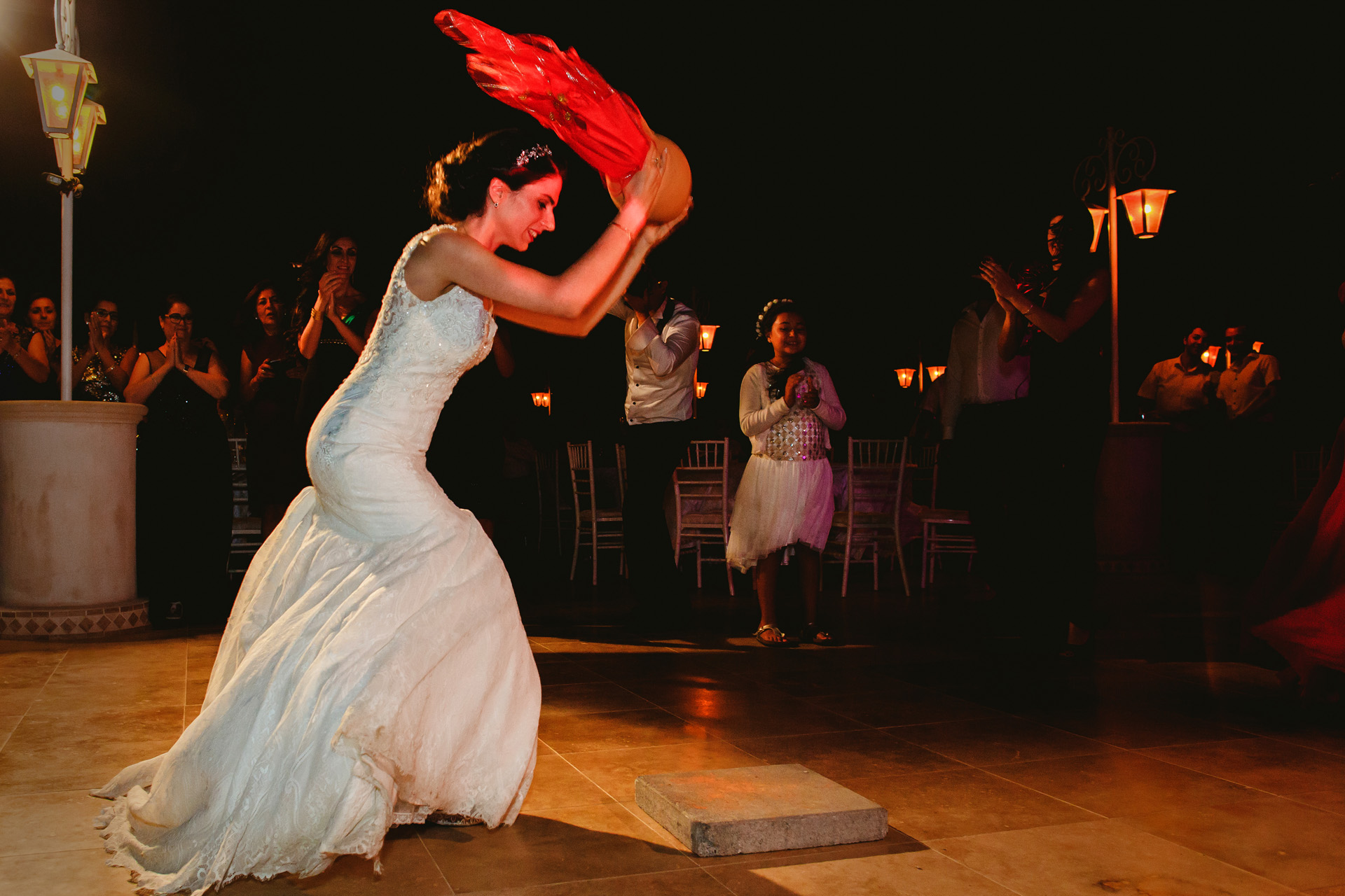 Elopement Wedding Traditions in Cyprus - Reception Photo | Candies and coins inside the jug go everywhere and kids come and get it all