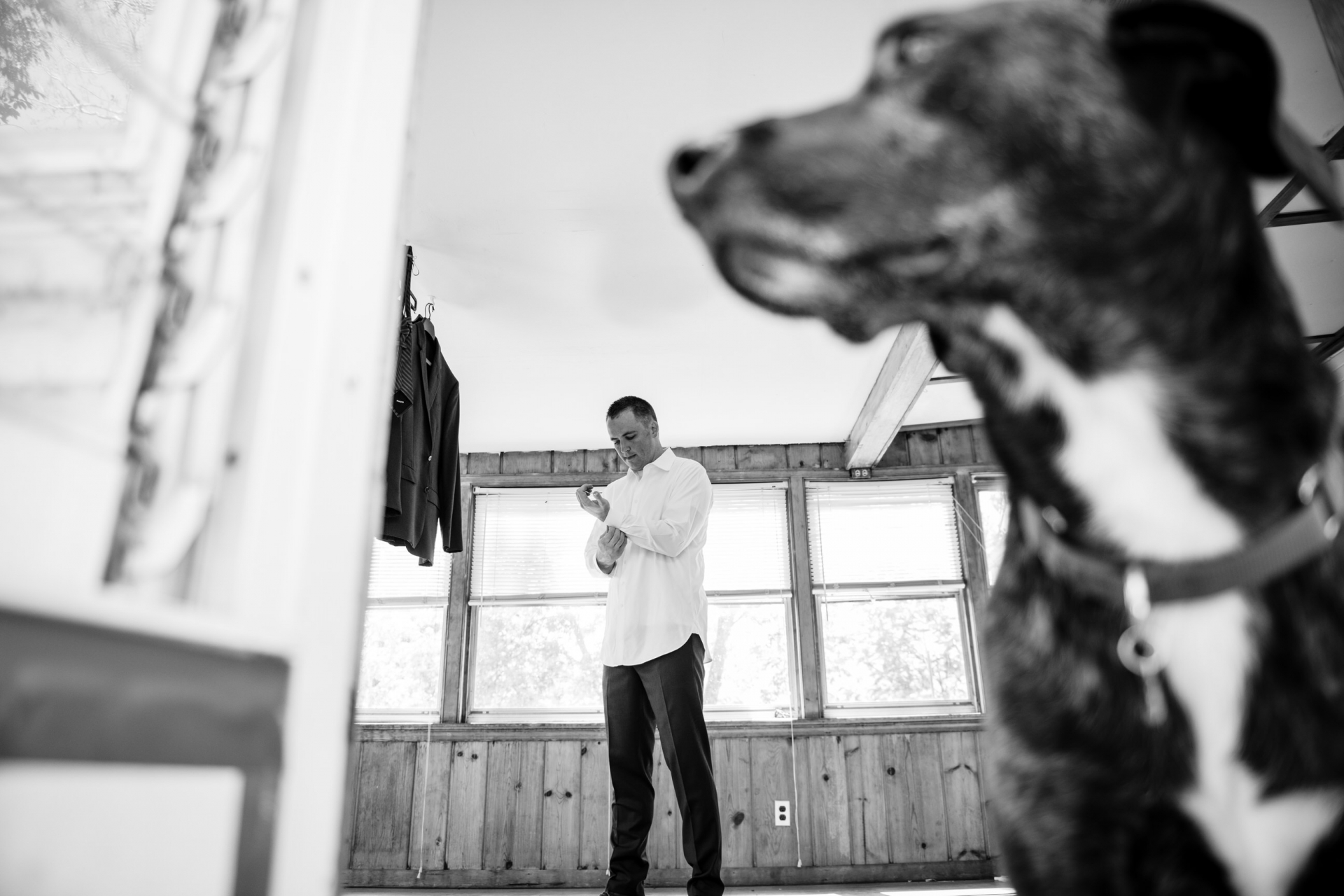 At-Home Maryland Wedding Photo | the groom getting ready with pup