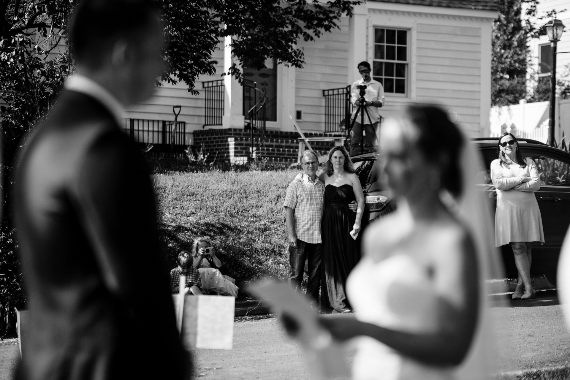 Outdoor Maryland Wedding Ceremony Photographer | Social distancing neighbors watch their private ceremony