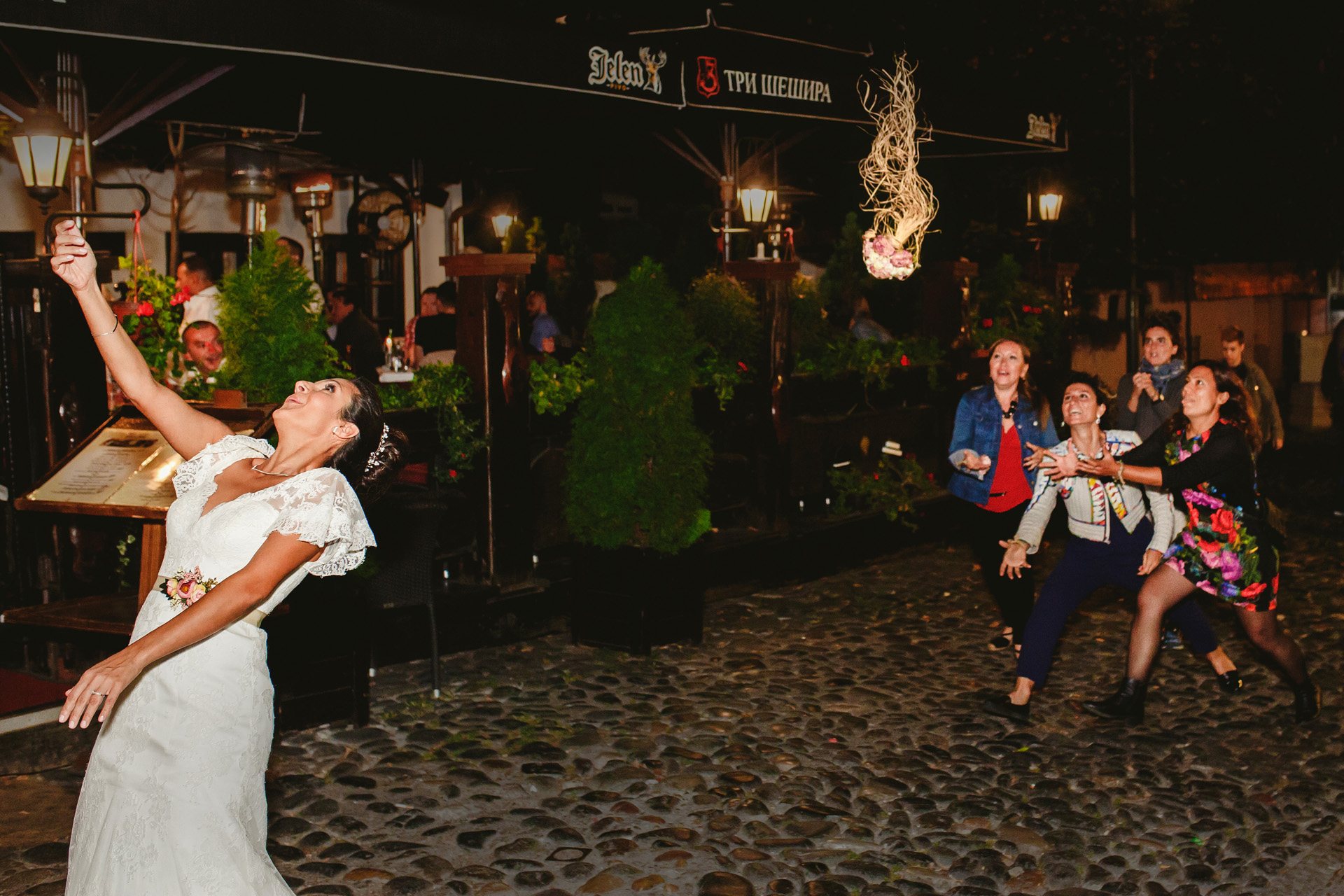 Serbia Elopement Wedding Party Celebration Photo | the bride threw her flowers to four single friends
