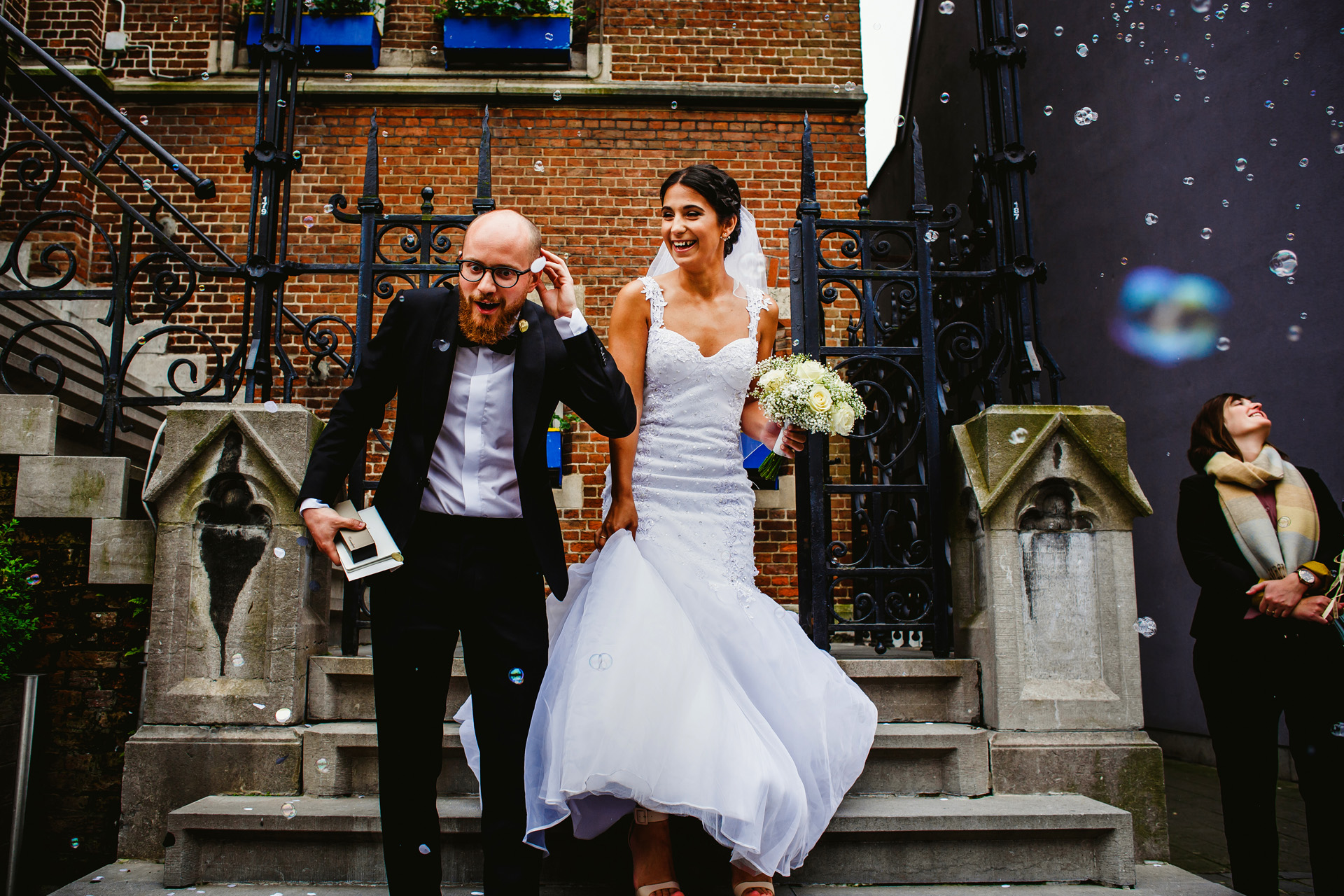 Antwerp, Belgium Elopement Photographer | After the ceremony, the newlyweds exit the city hall