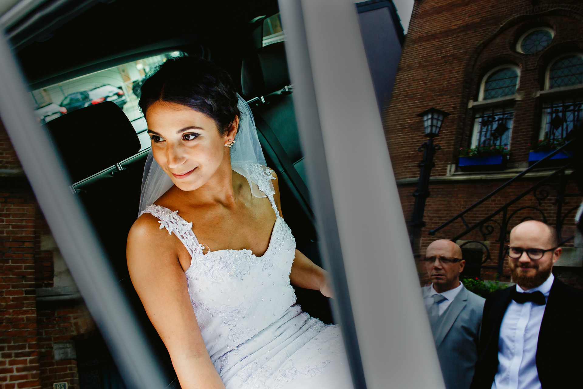 Belgium Elopement Picture of the bride | sitting inside the car now with the door open, looks out after the groom