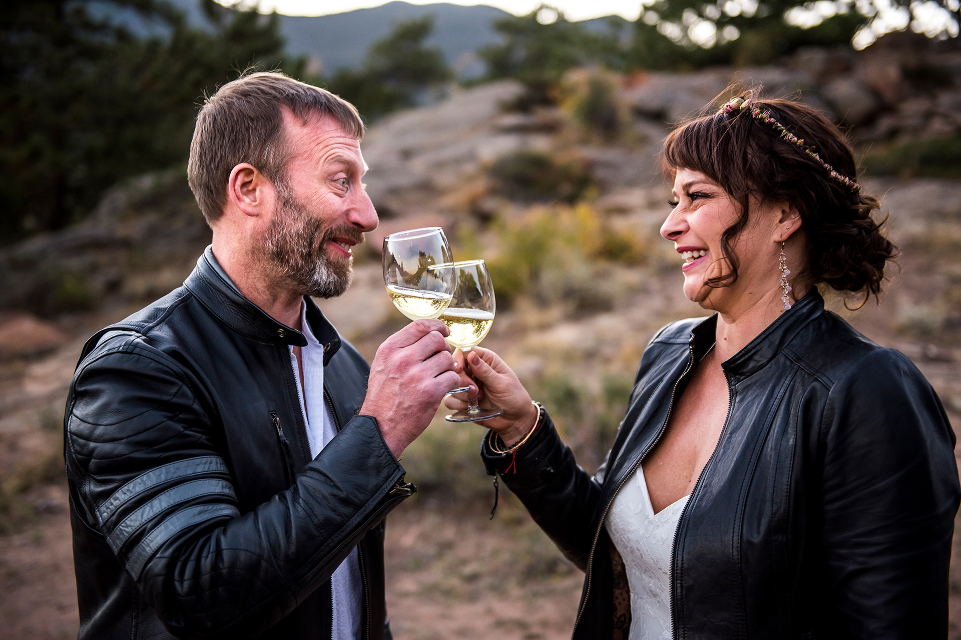 CO Wedding Elopement Toast Picture | a glass of champagne immediately after their private, outdoor Estes Park ceremony