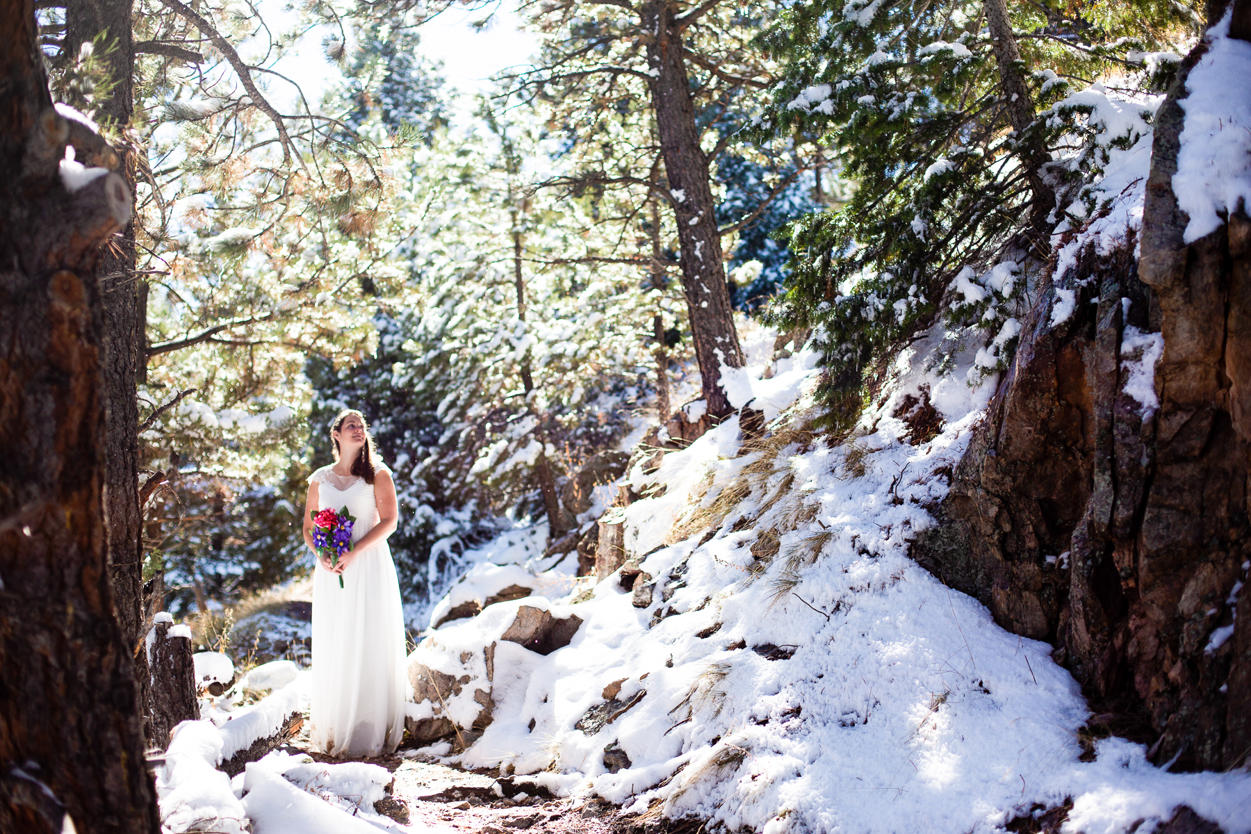 Eldorado Canyon, Colorado Bride Wedding Image | the bride turned to look at some snow falling off a tree further uphill