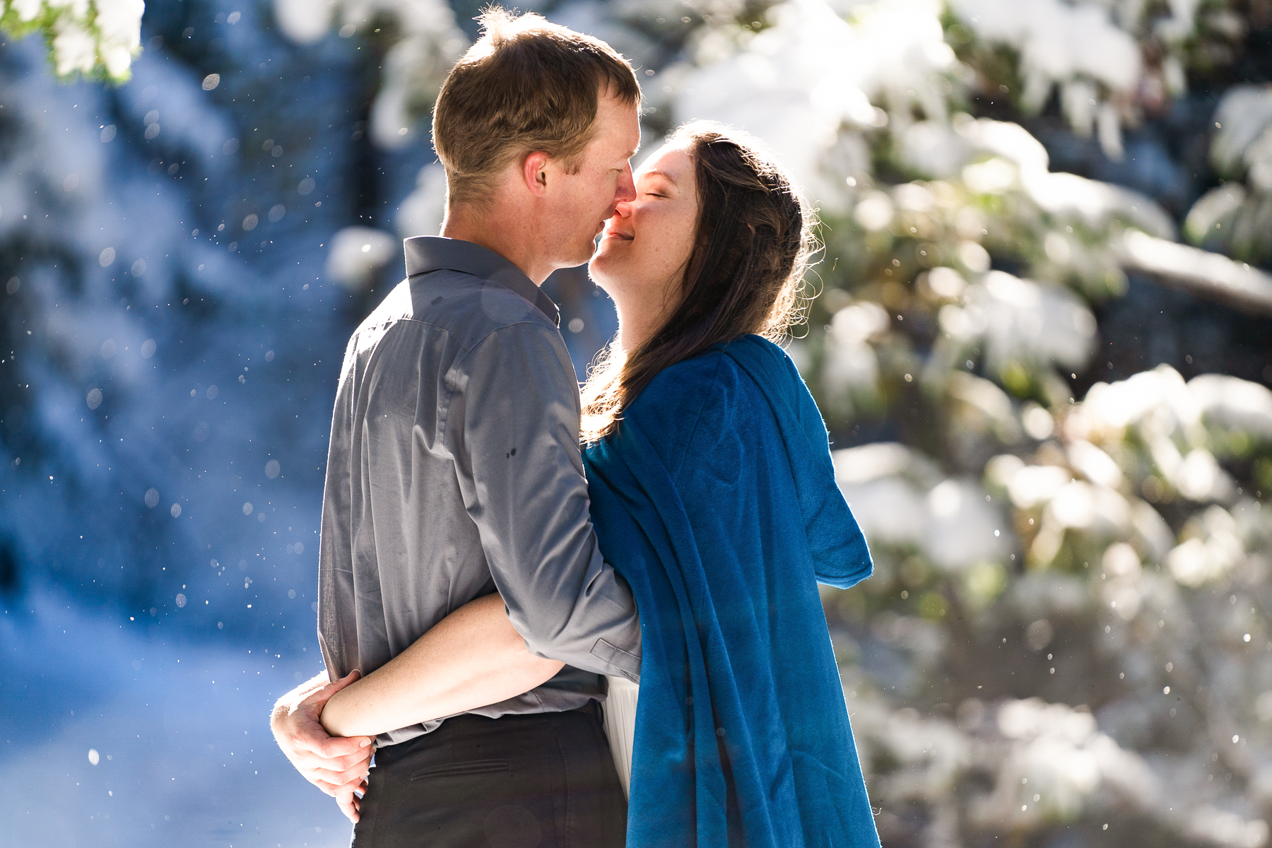 CO Adventure Elopement Wedding Photography | snow kept falling all around them, and a shaft of sunlight was too beautiful to pass