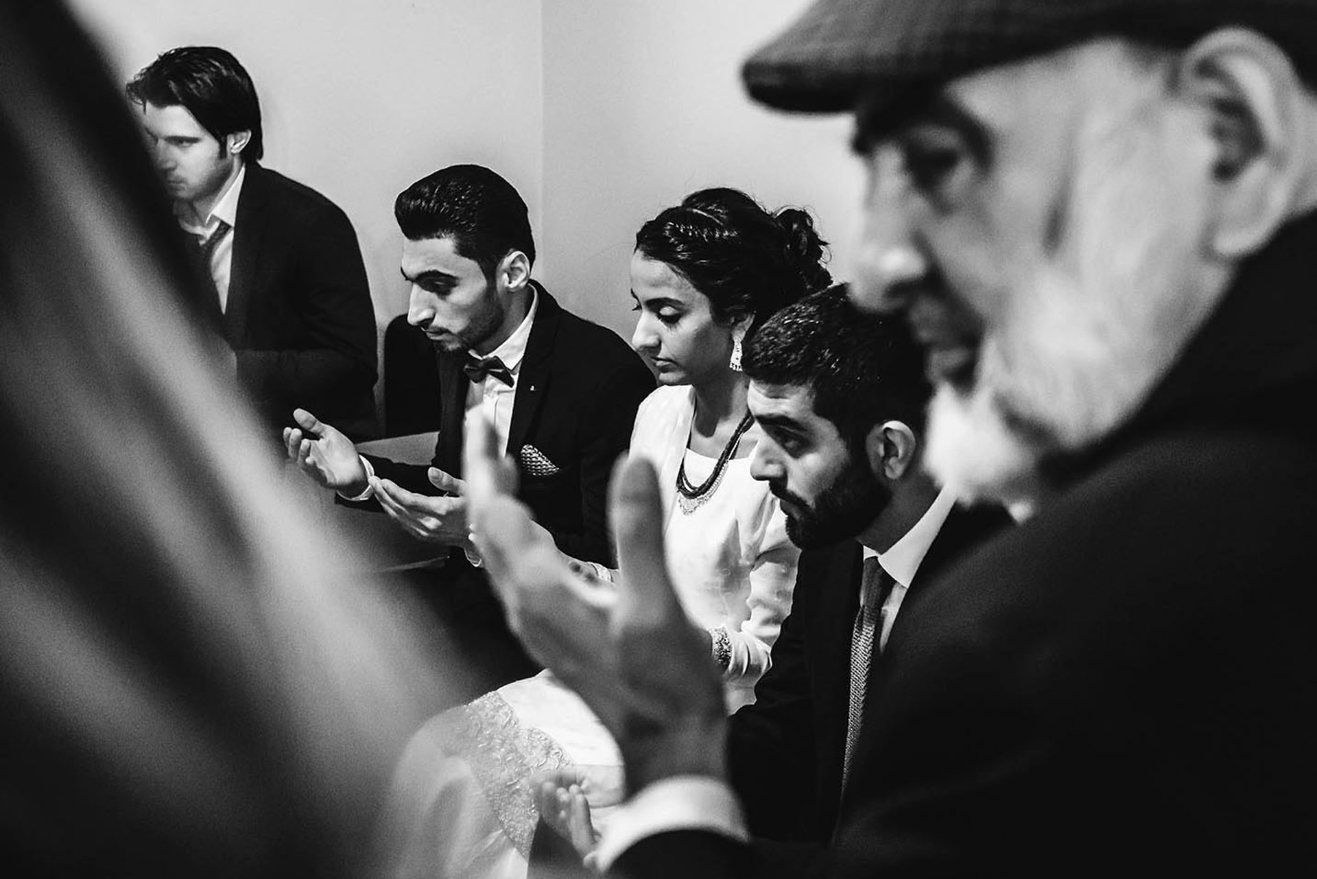 Istanbul, Turkey Elopement Ceremony Photography | During the ceremony, the prayers begin, and the couple and their guests turn their hands up