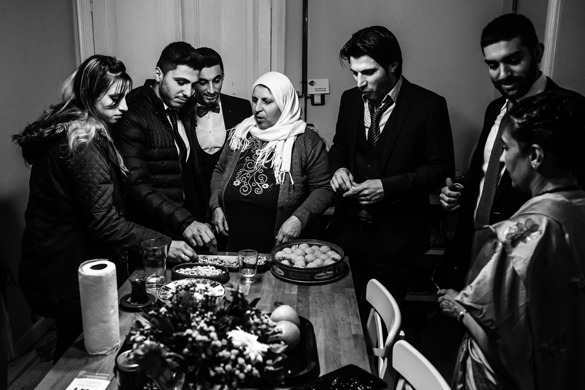Istanbul, Turkey Elopement Party Picture | After the ceremony, all the guests gather around a modest table