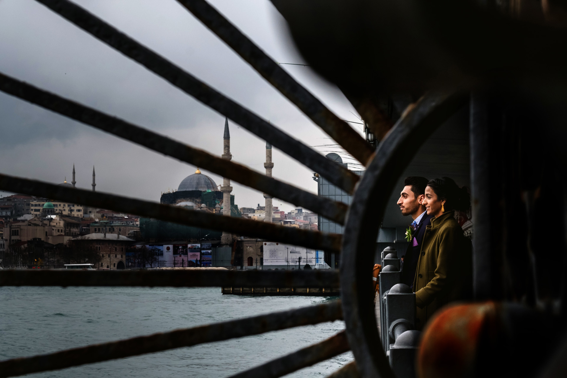 Galata Bridge, Galata, Istanbul, Turkey Elopement Portrait | The couple stands together under the Bridge of Galata in the center of the old town