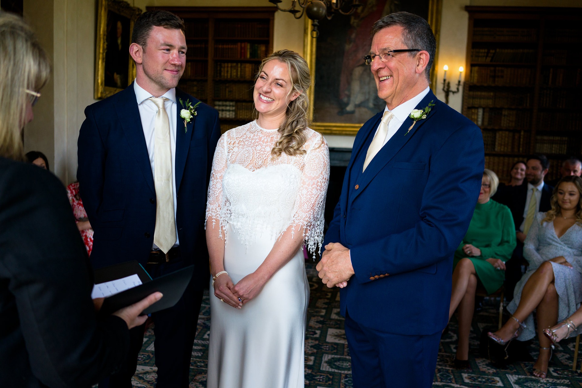 Devon, UK Elopement Ceremony Photography | the ceremony begins and the guests watch from their seats