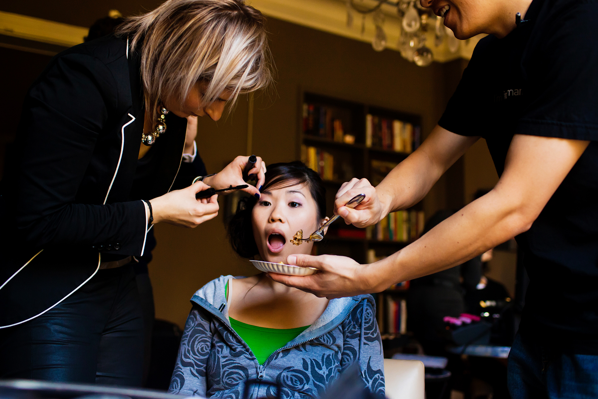 Paris Elopement Getting Ready Image | the bride has to sit still to have her mascara applied,