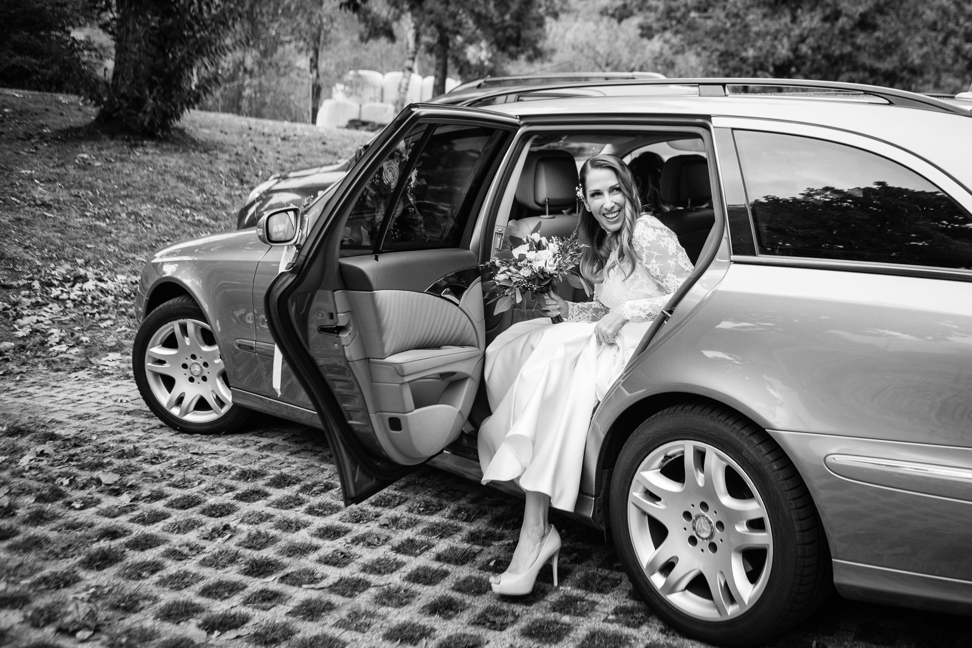 Wedding Image of a Switzerland Bride | The bride prepares to step out of the car
