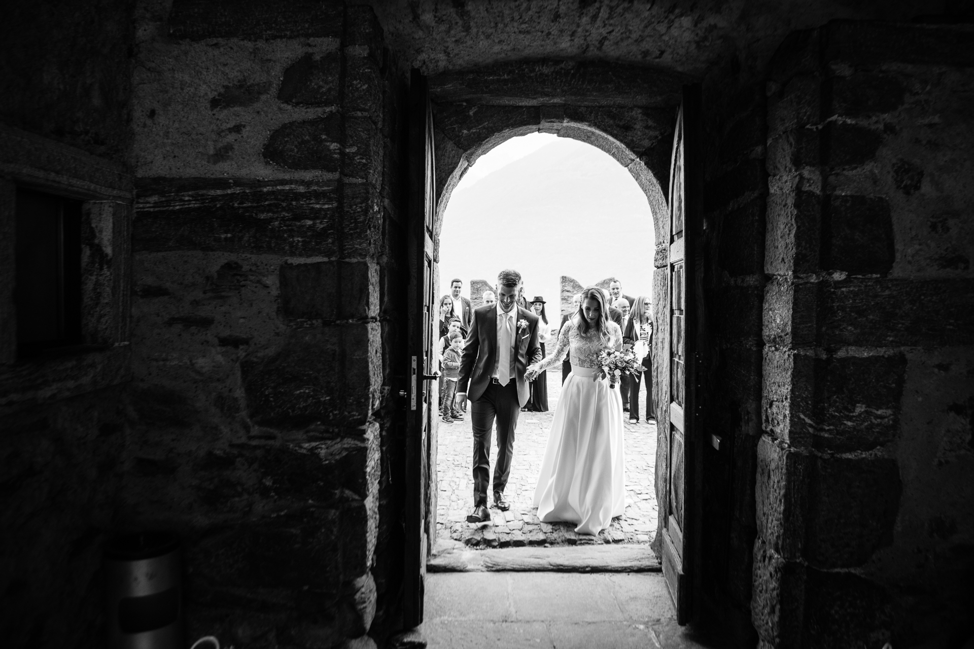 Bellinzona (CH) Wedding Photography | The inside of the castle is made up of rustic stone walls
