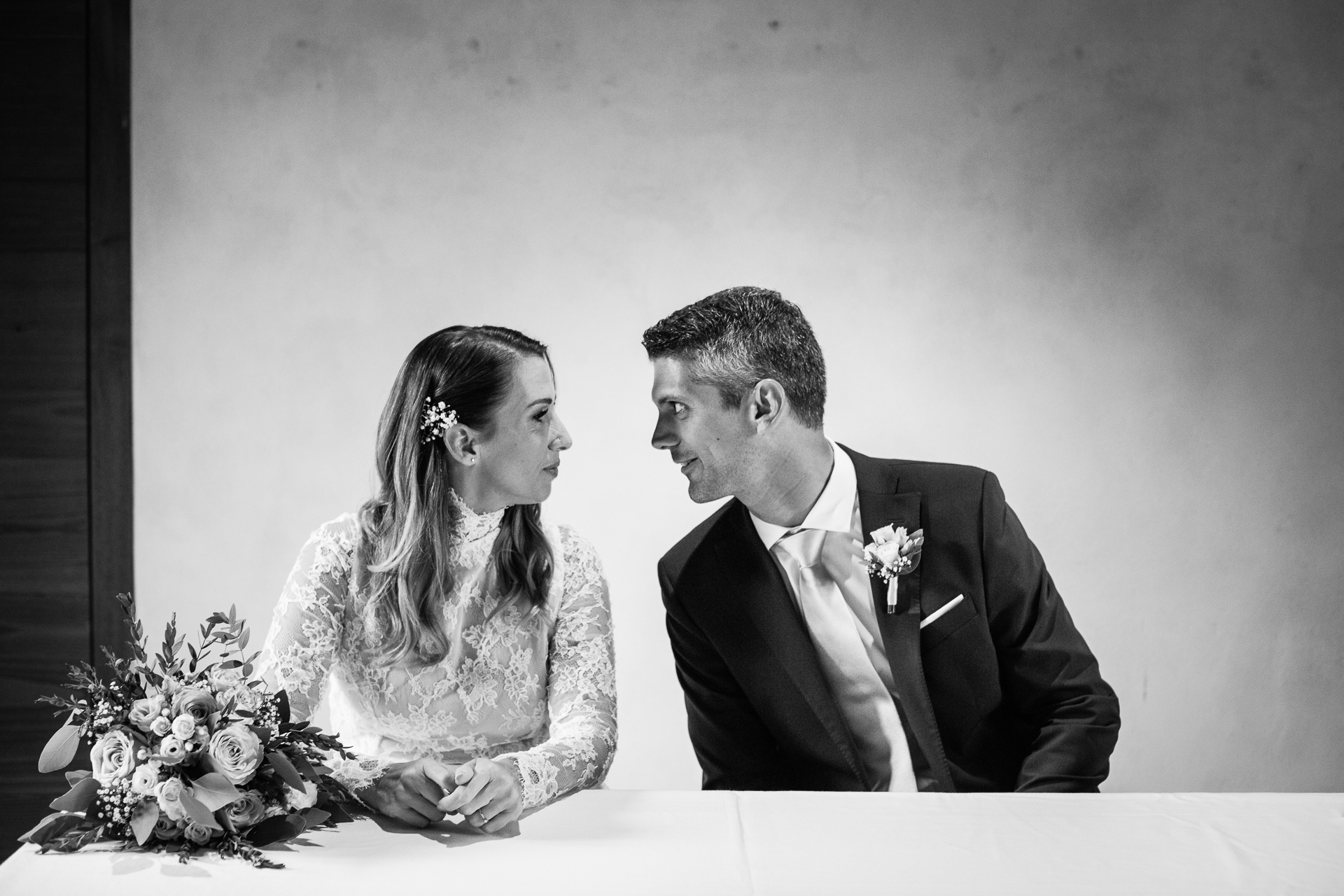 CH Elopement Image   as the couple is seated at the table where they will be married, the groom leans over to the bride