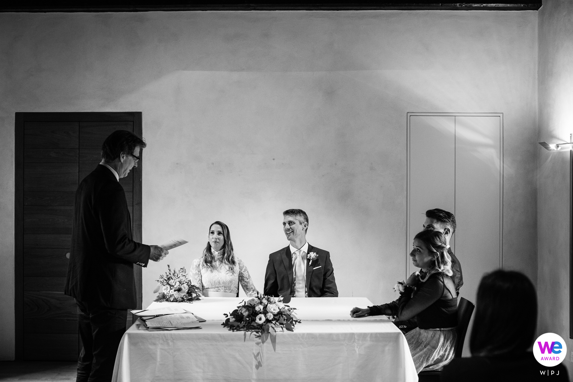 Castles of Bellinzona, Switzerland Elopement Photography   the couple sits at a table together with their eyes on the mayor