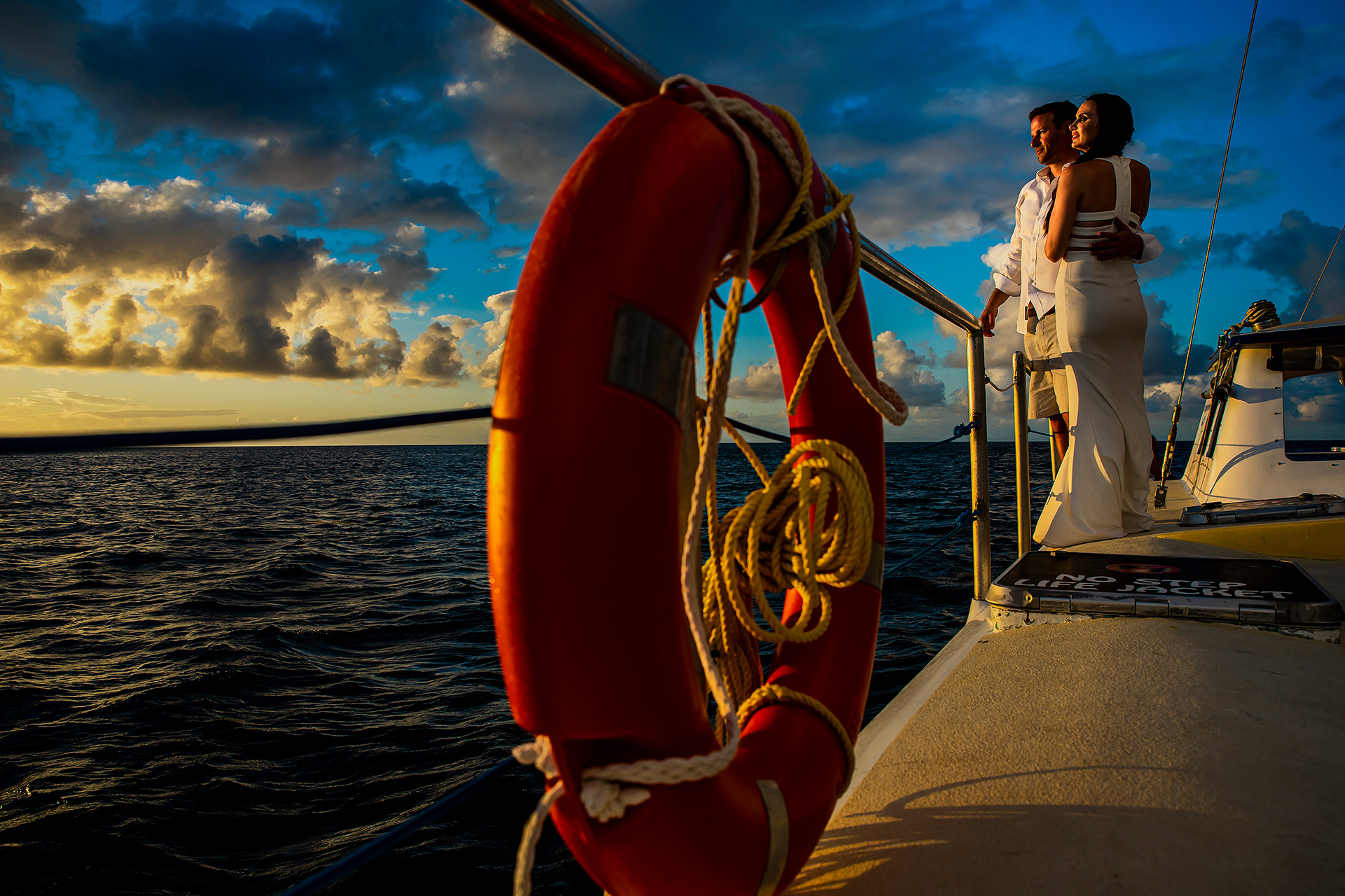 Sunset Elopement Couple Portrait in St. Lucia | The bride and groom-to-be watching the sunset