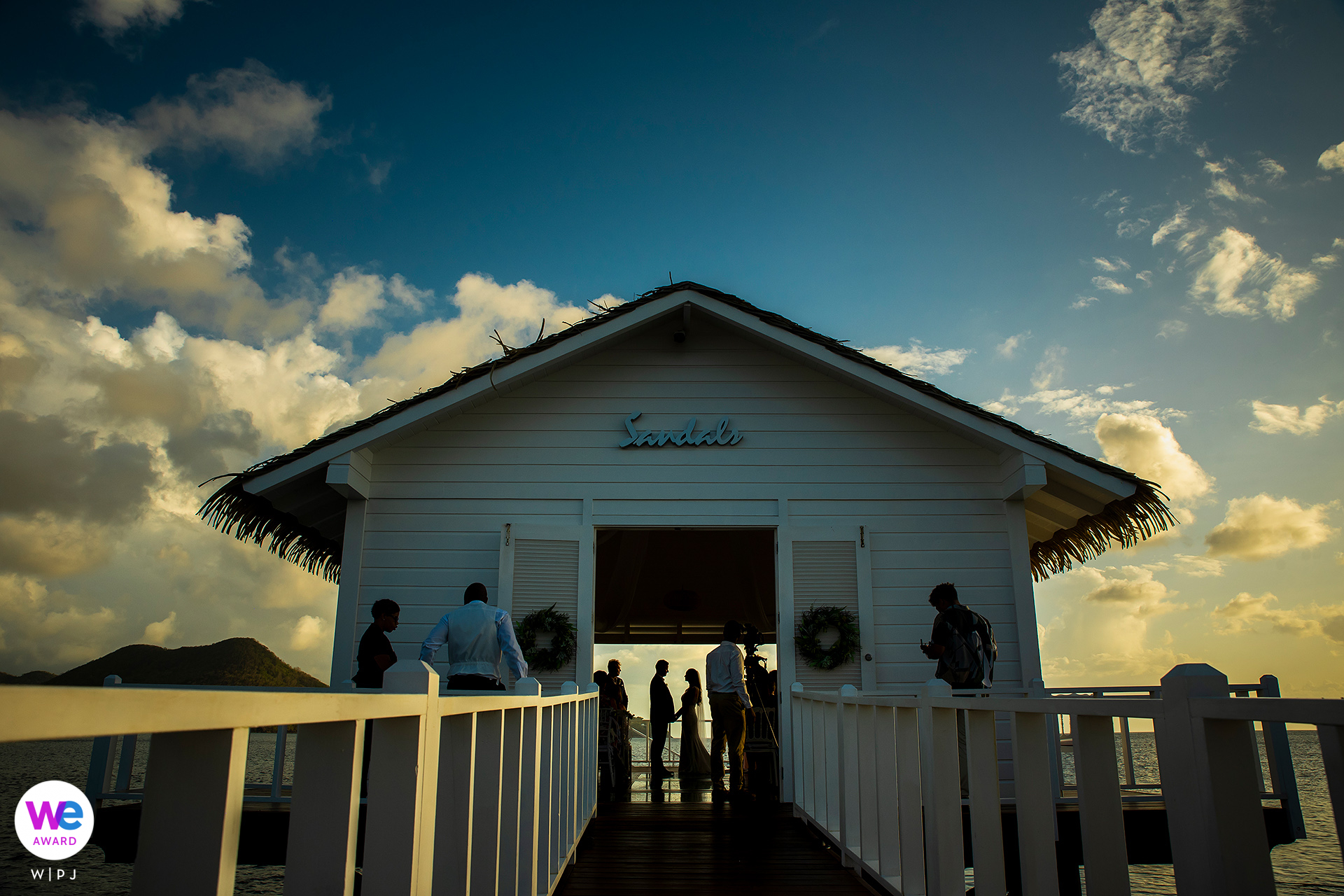 St. Lucia Elopement Ceremony Photography | The bride and groom tie the knot in a small, overwater bungalow