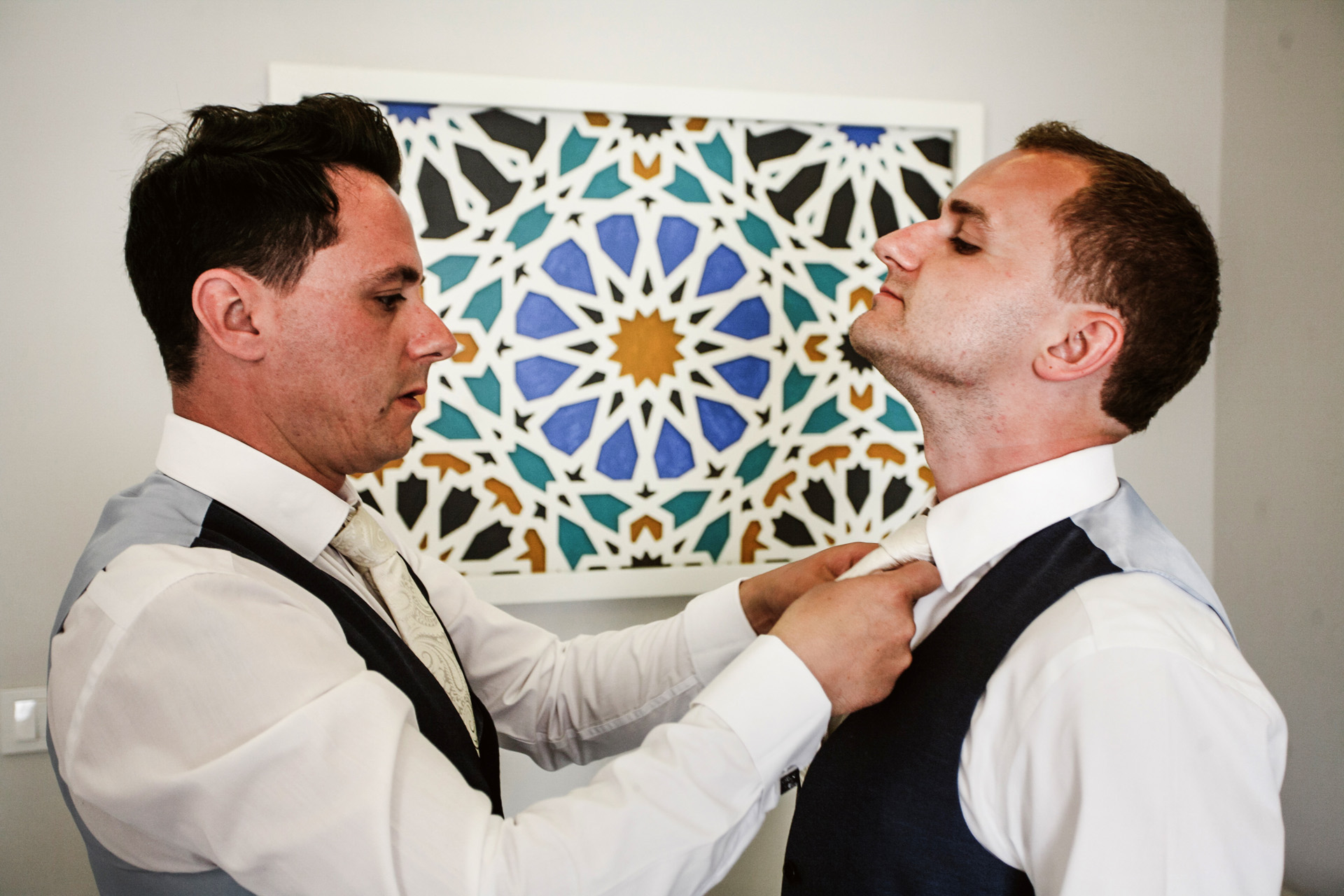 Fethiye, Turkey Elopement Groom Getting Ready Picture | the groom's best man helps him with his tie