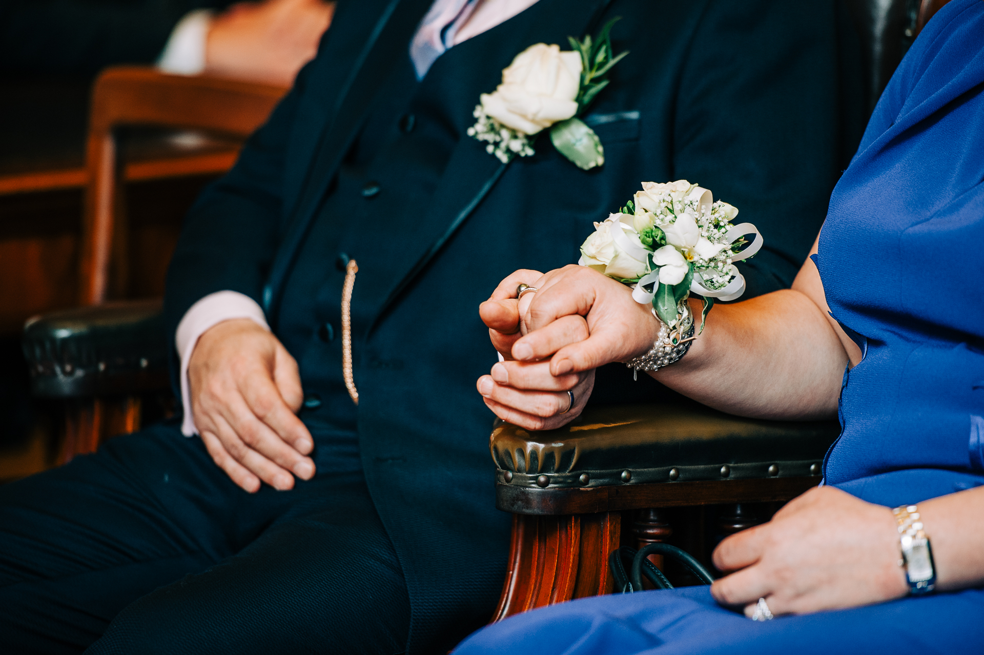 Brighton Town Hall Elopement Ceremony Detail Photo | The bride wore a striking blue dress and a wrist corsage of white roses