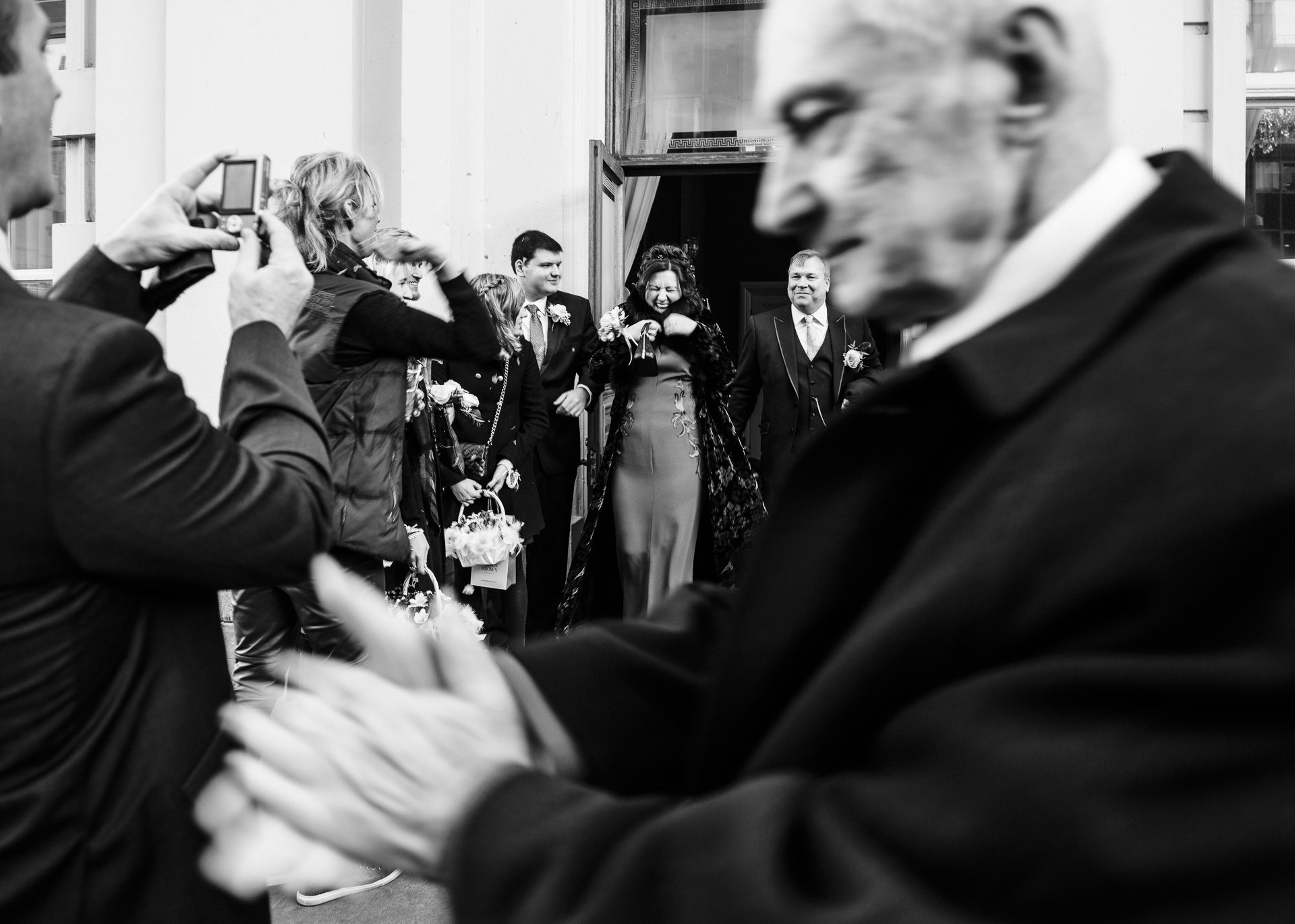UK Town Hall Elopement Celebration Image | as the newly married couple exited Brighton Town Hall