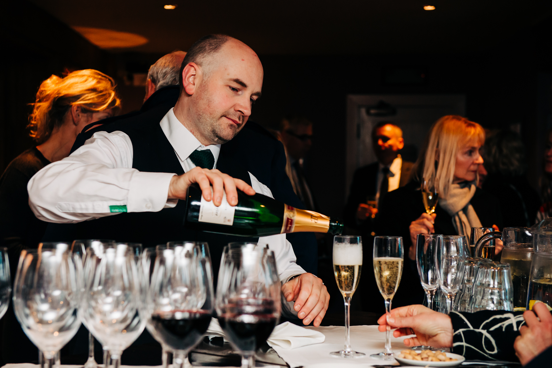 Hotel Du Vin, Brighton Elopement Bar Shot | A wine waiter pours champagne
