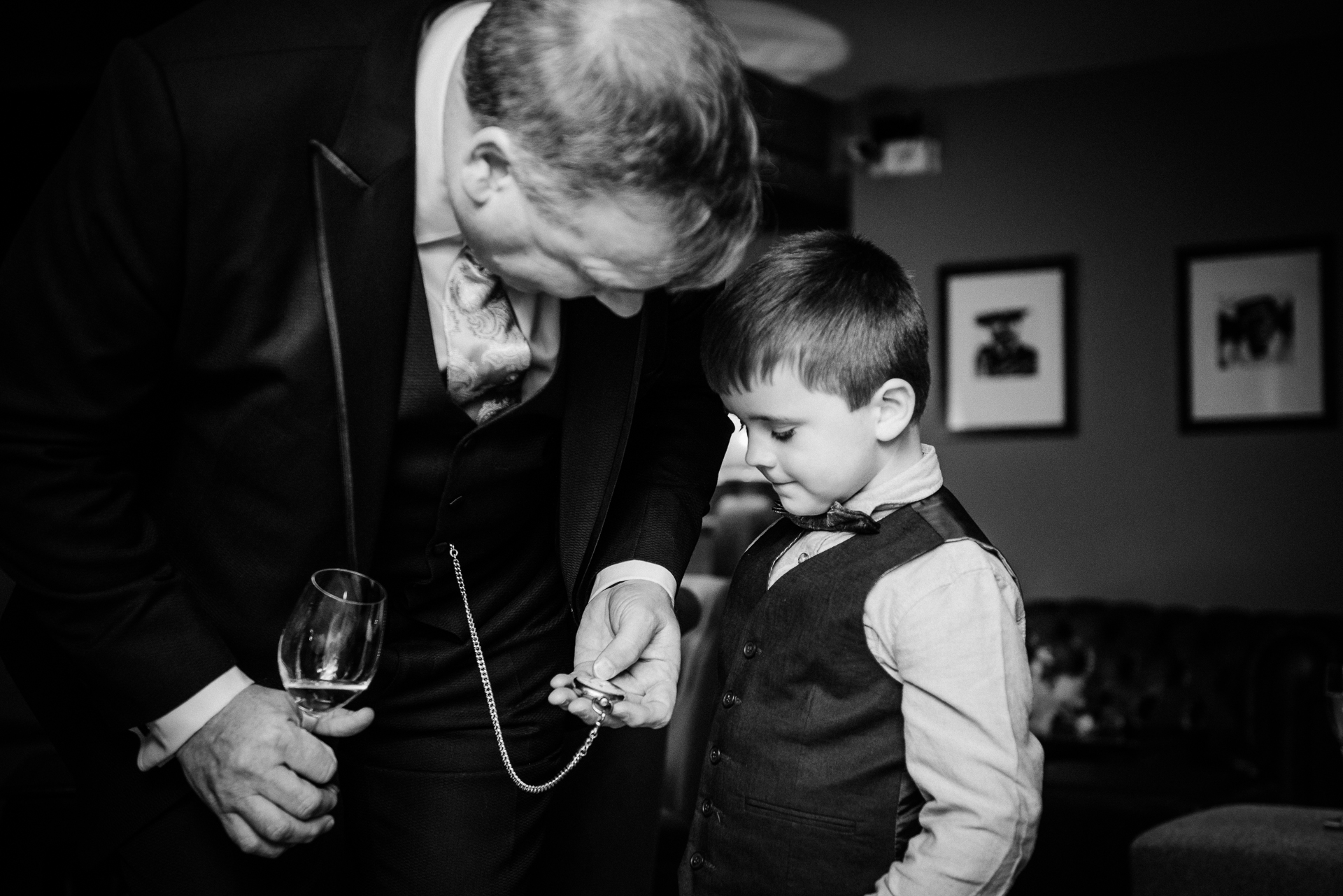 Brighton Elopement Groom w/ Kid Image | The groom takes out his pocket watch