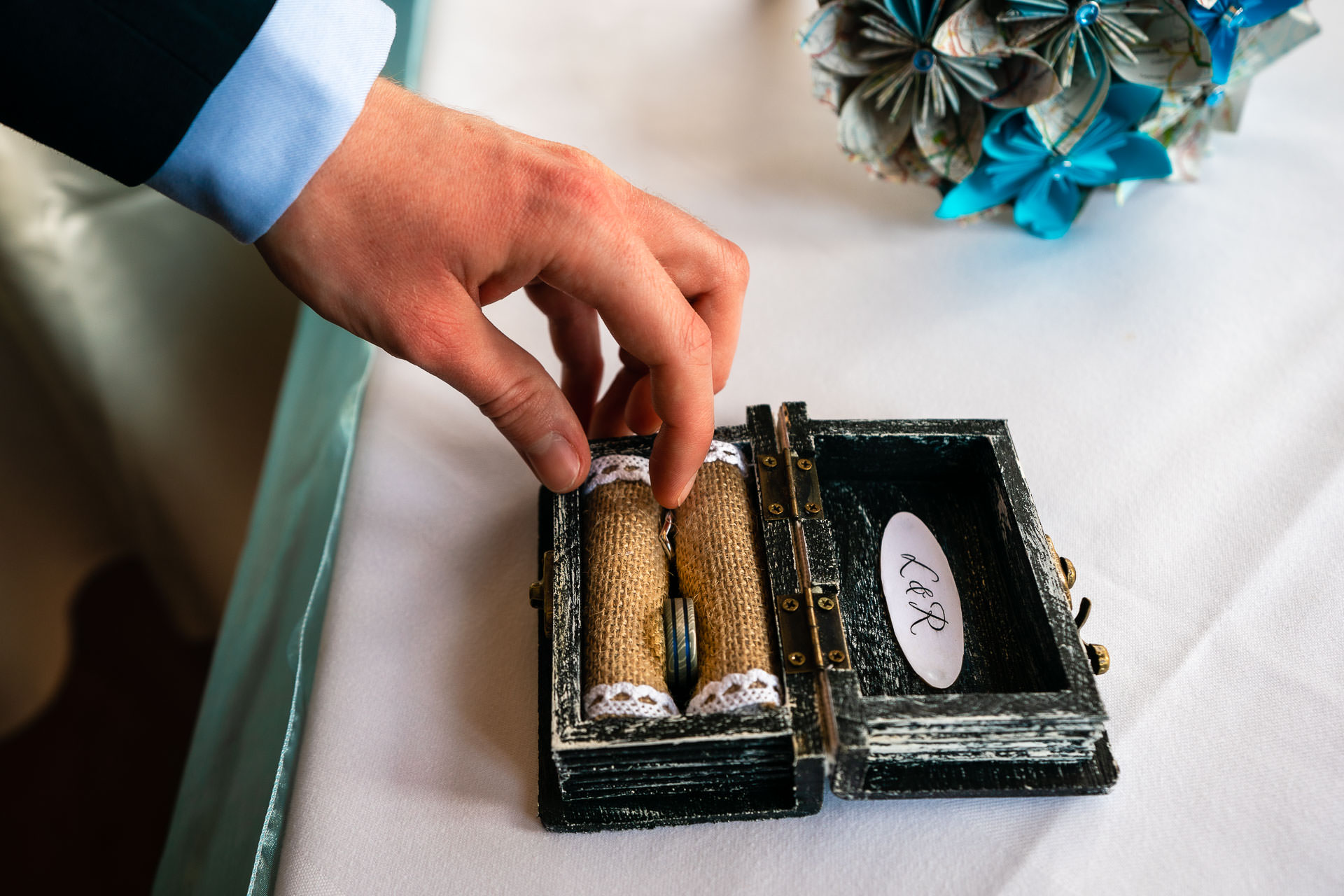 Berkshire UK Elopement Ring Detail Image | The groom is taking the bride's ring from a custom made ring box