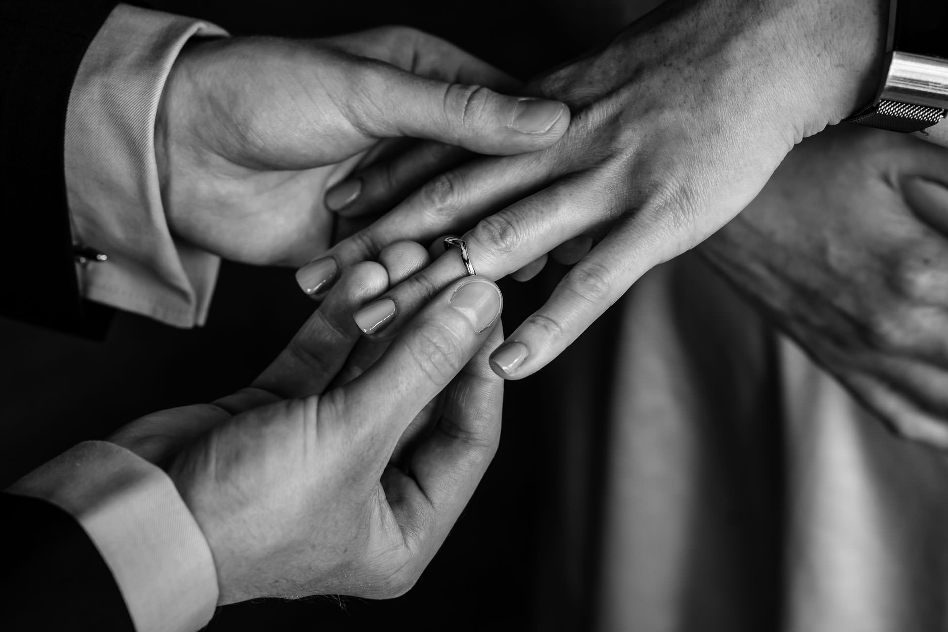 Berkshire United Kingdom Elopement Rings Picture | The groom putting on the bride's ring