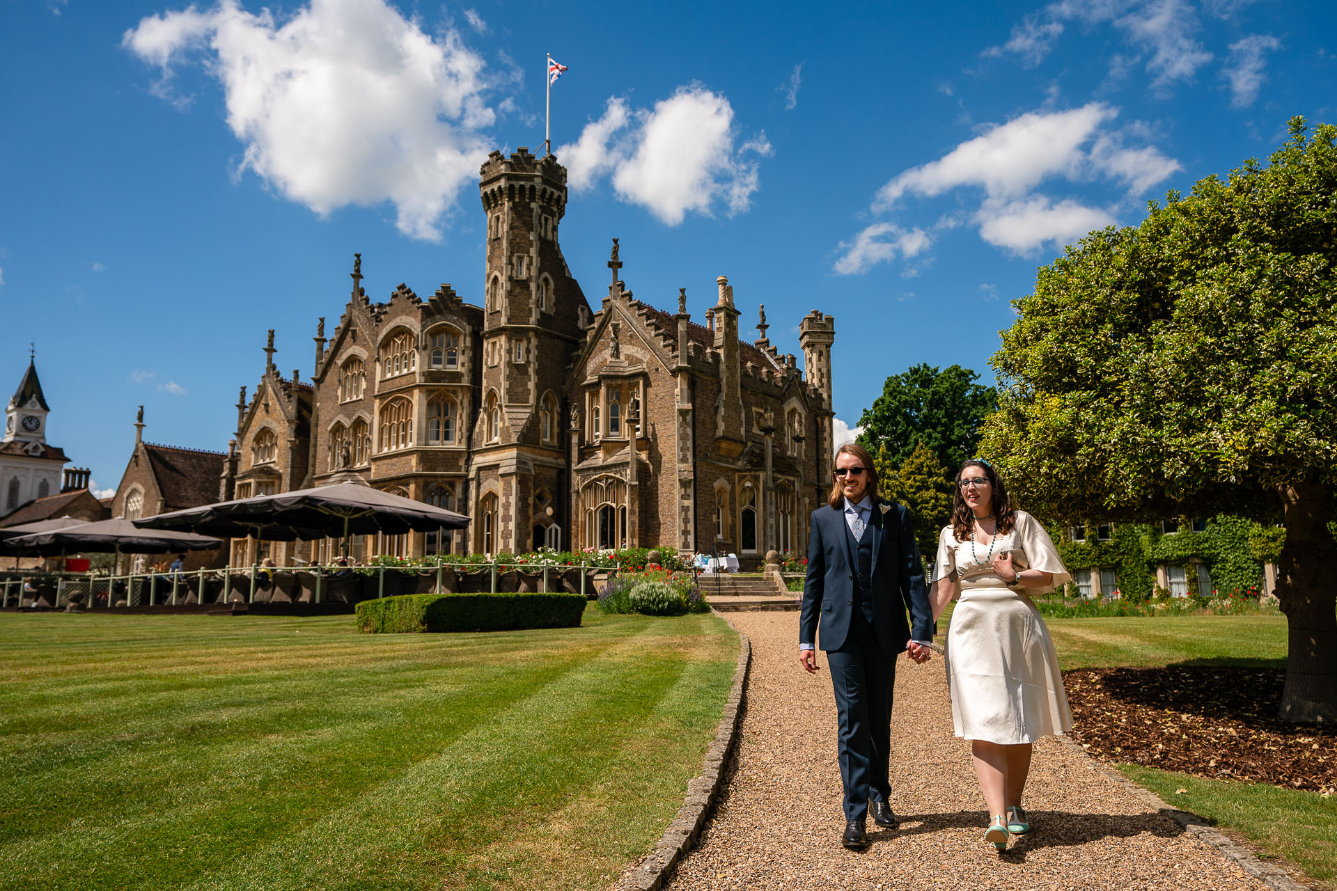 Windsor UK Elopement Couple Photography | The newlyweds walking in the grounds of The Oakley Court hotel
