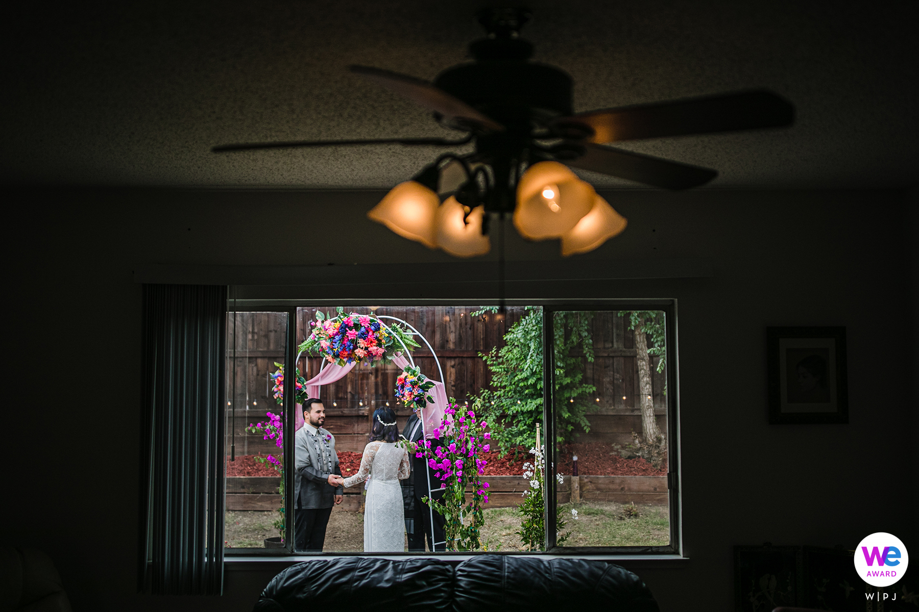 Wedding ceremony in their backyard Antioch, California - Elopement Photographer | Through the couple's living room window, we can see them in their backyard
