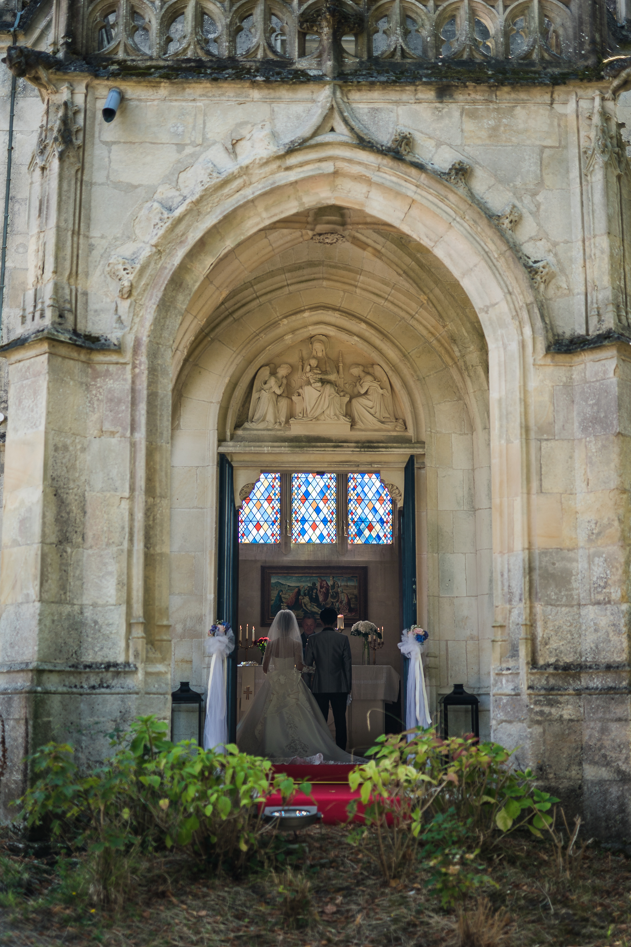 Elopement Ceremony Picture from Mirambeau Castle | the doors to the wedding chapel stand open