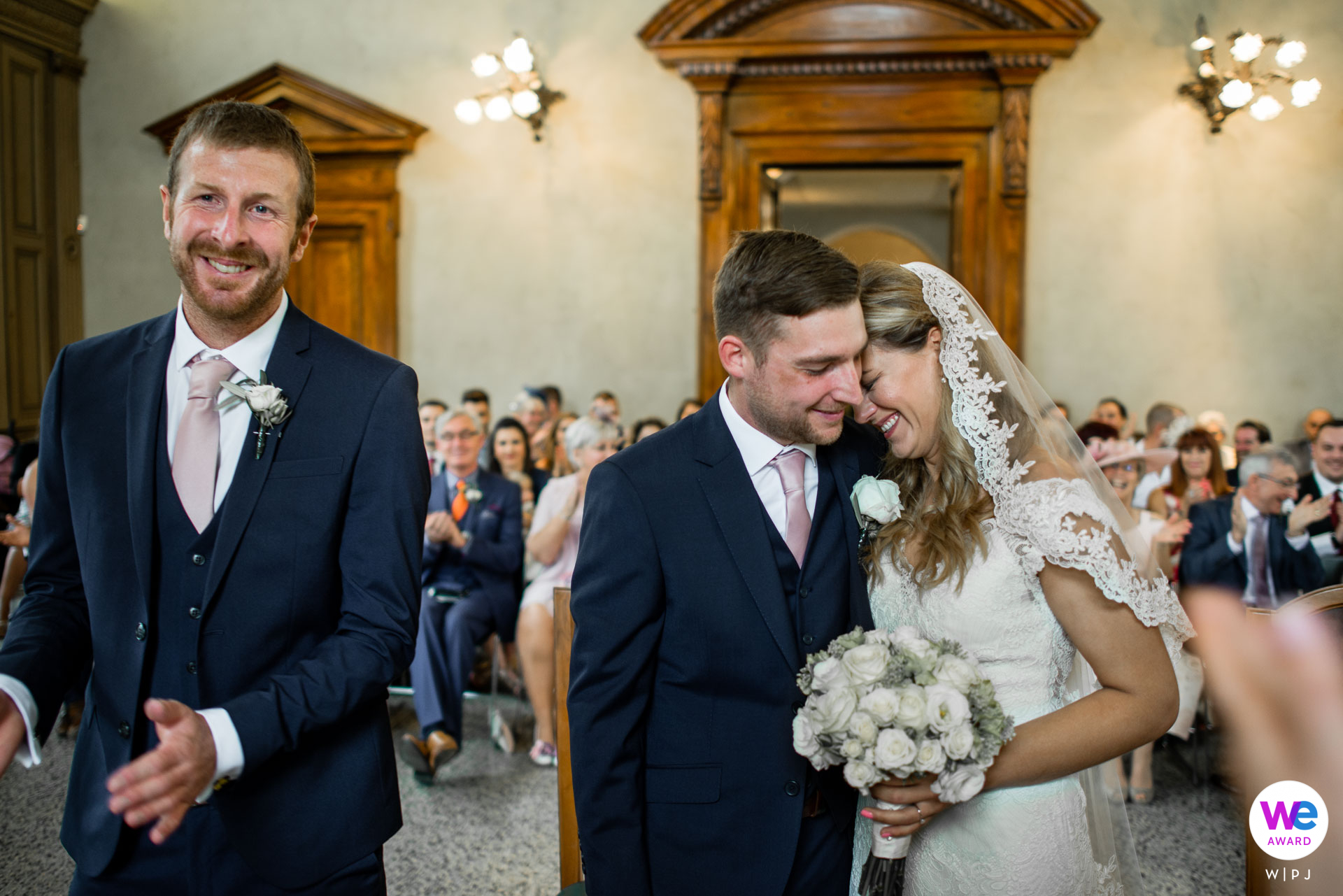 Town Hall of Salò, Brescia, Italy Elopement Photographer | the bride and groom hug for the first time on their wedding day
