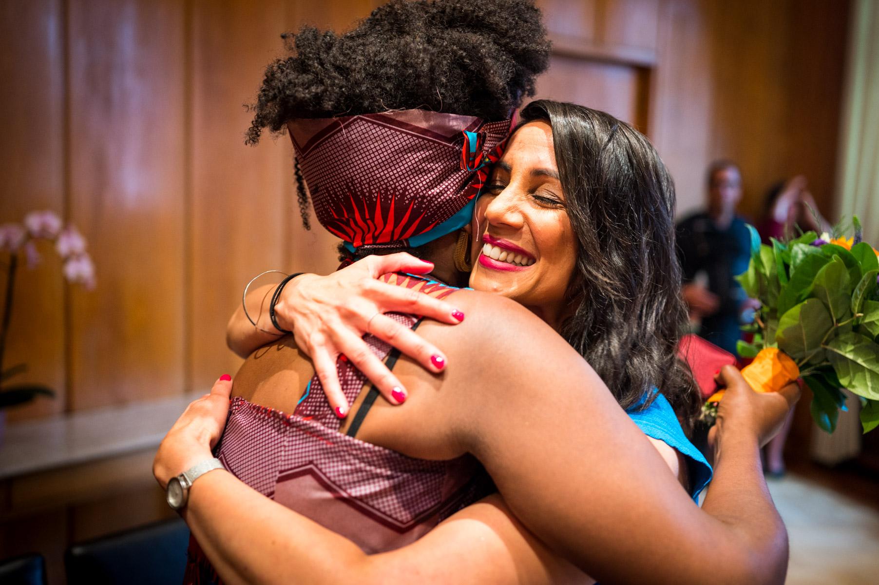 Romer Frankfurt City Hall Civil Elopement Photographer   After the ceremony, the bride hugs her friend