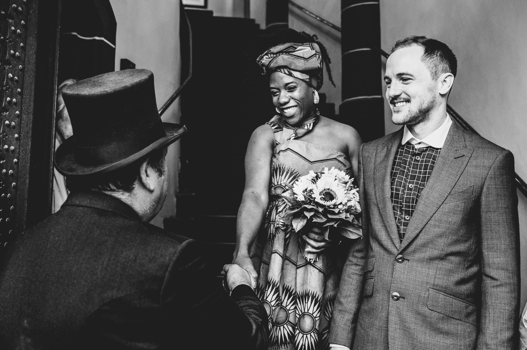 Frankfurt Elopement Couple Picture | the bride, standing next to her smiling groom, shakes hands with a man