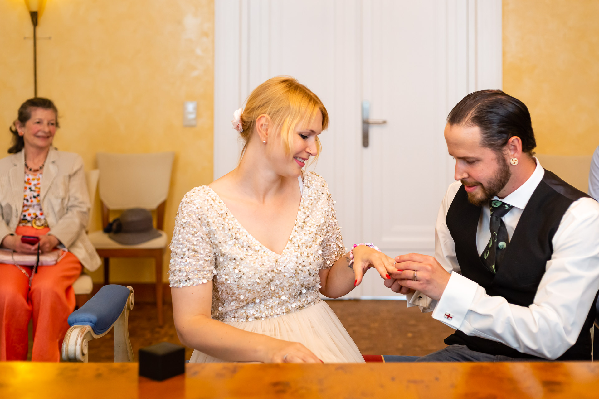 City Hall Dudelange Elopement Picture | It's time to exchange rings, and the bride watches the groom