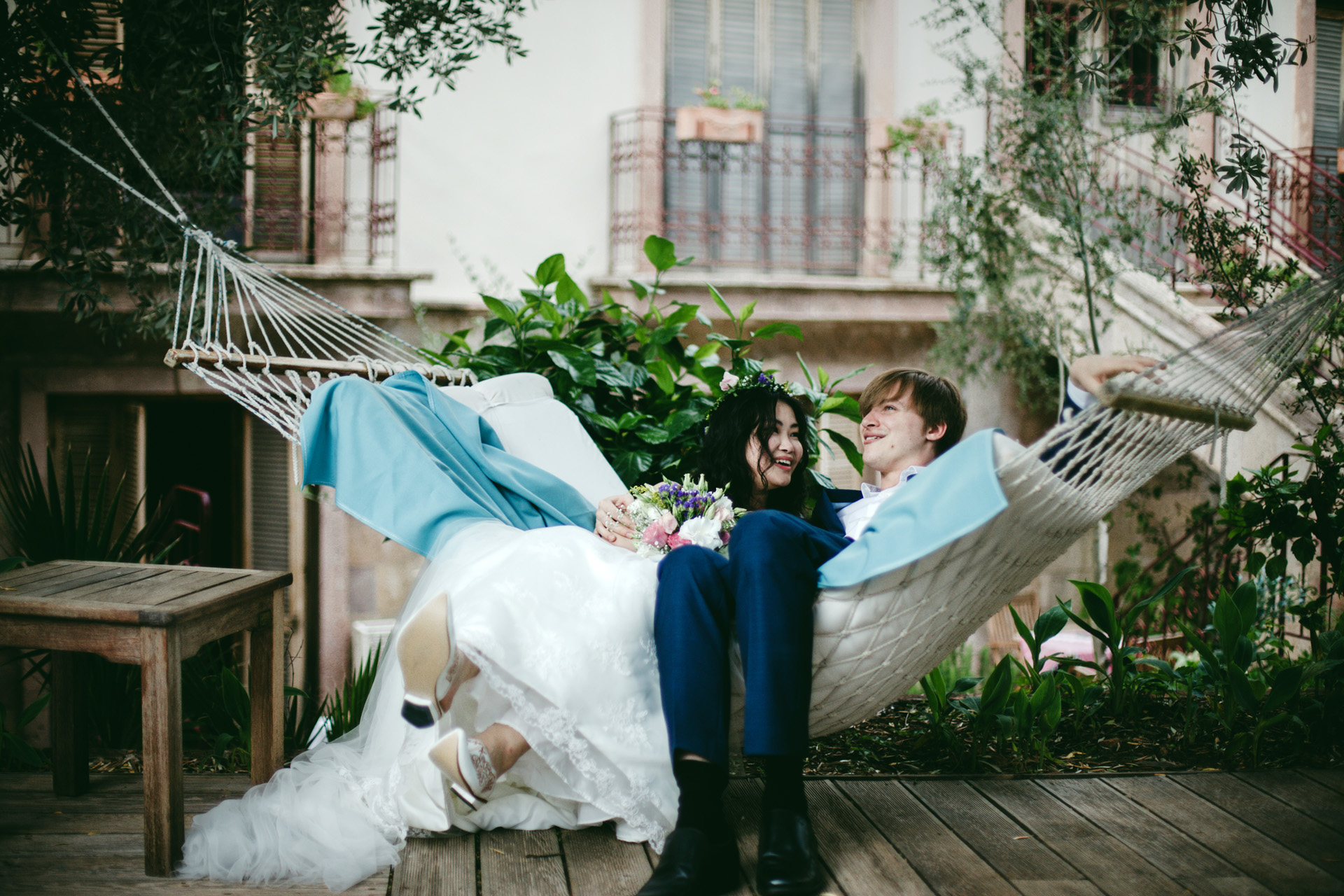 Turkey Elopement Couple Portrait | the couple laid down into a hammock in the garden
