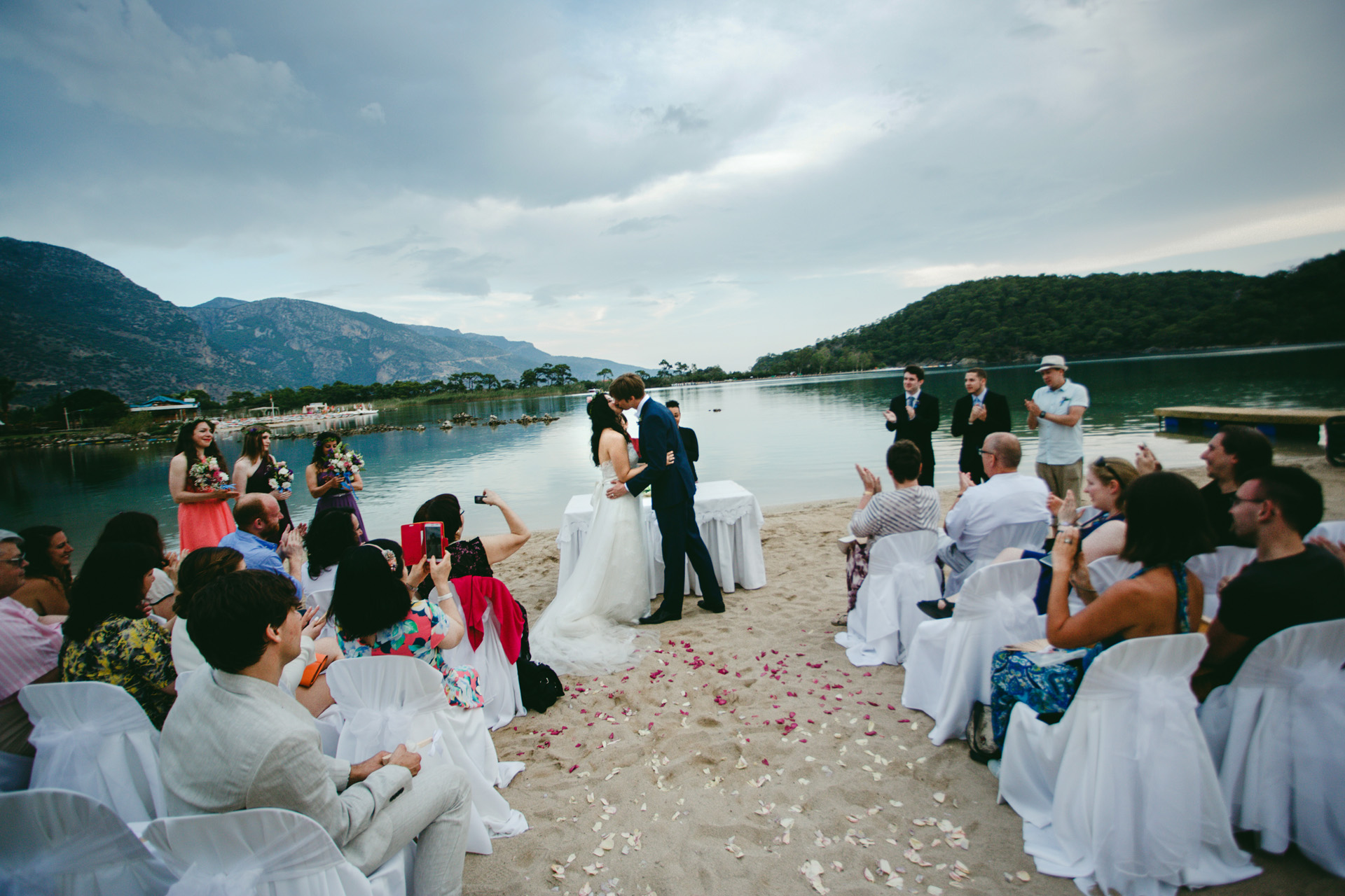 Oyster Residences Elopement Beach Ceremony Photo | This image shows the first kiss at the end of the ceremony