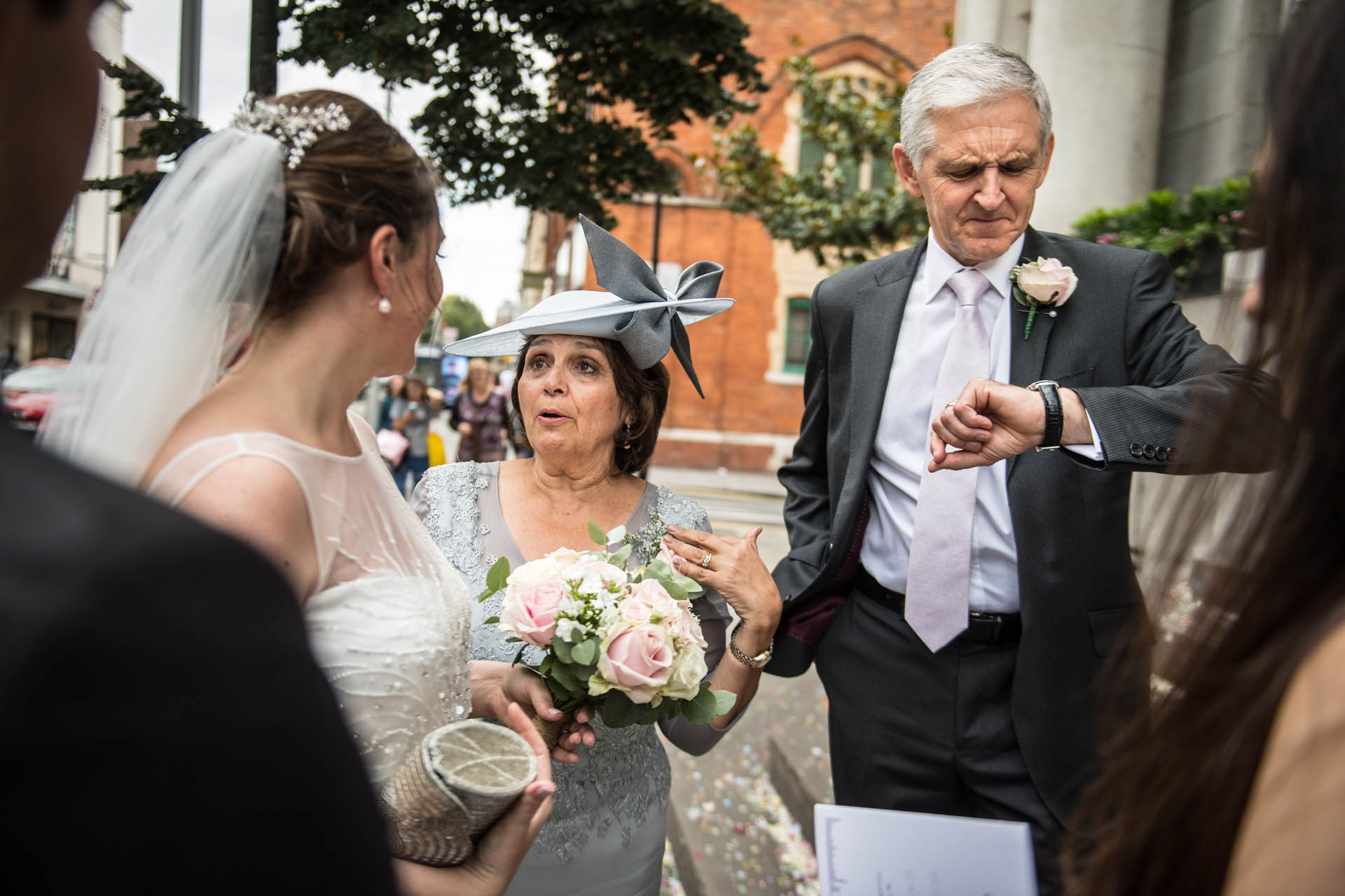 Chelsea, London Elopement Photo | Outside the town hall, the bride waits for a cab